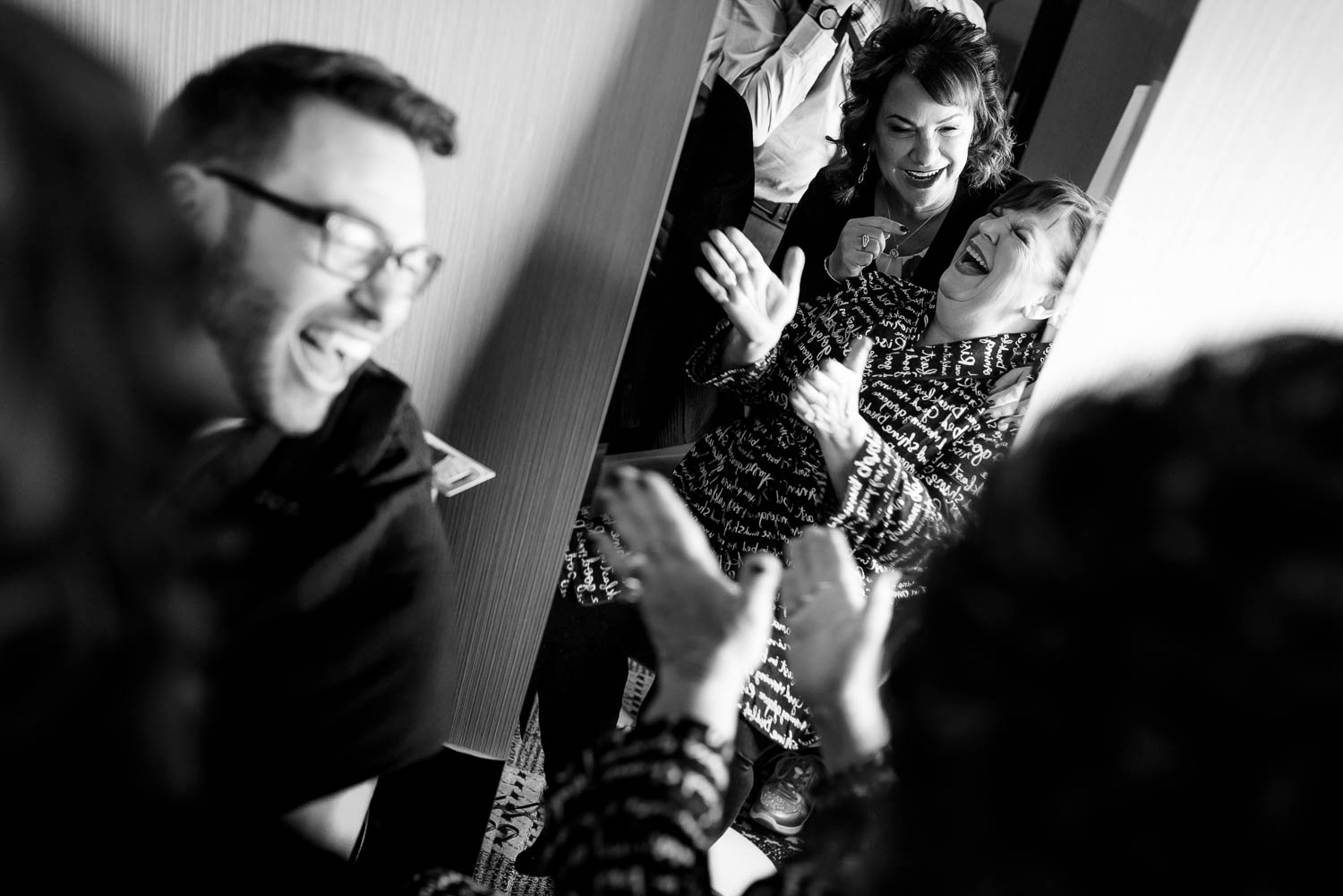 Documentary moment mother of the bride laughing at Hotel Lincoln during a Chicago wedding.