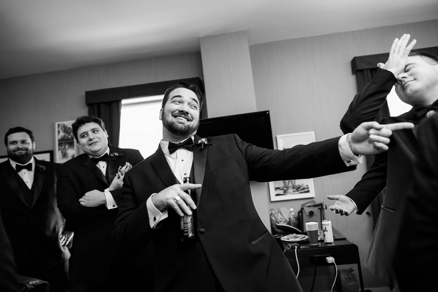 Funny moment with the groomsmen while getting ready at Hotel Lincoln Chicago wedding.