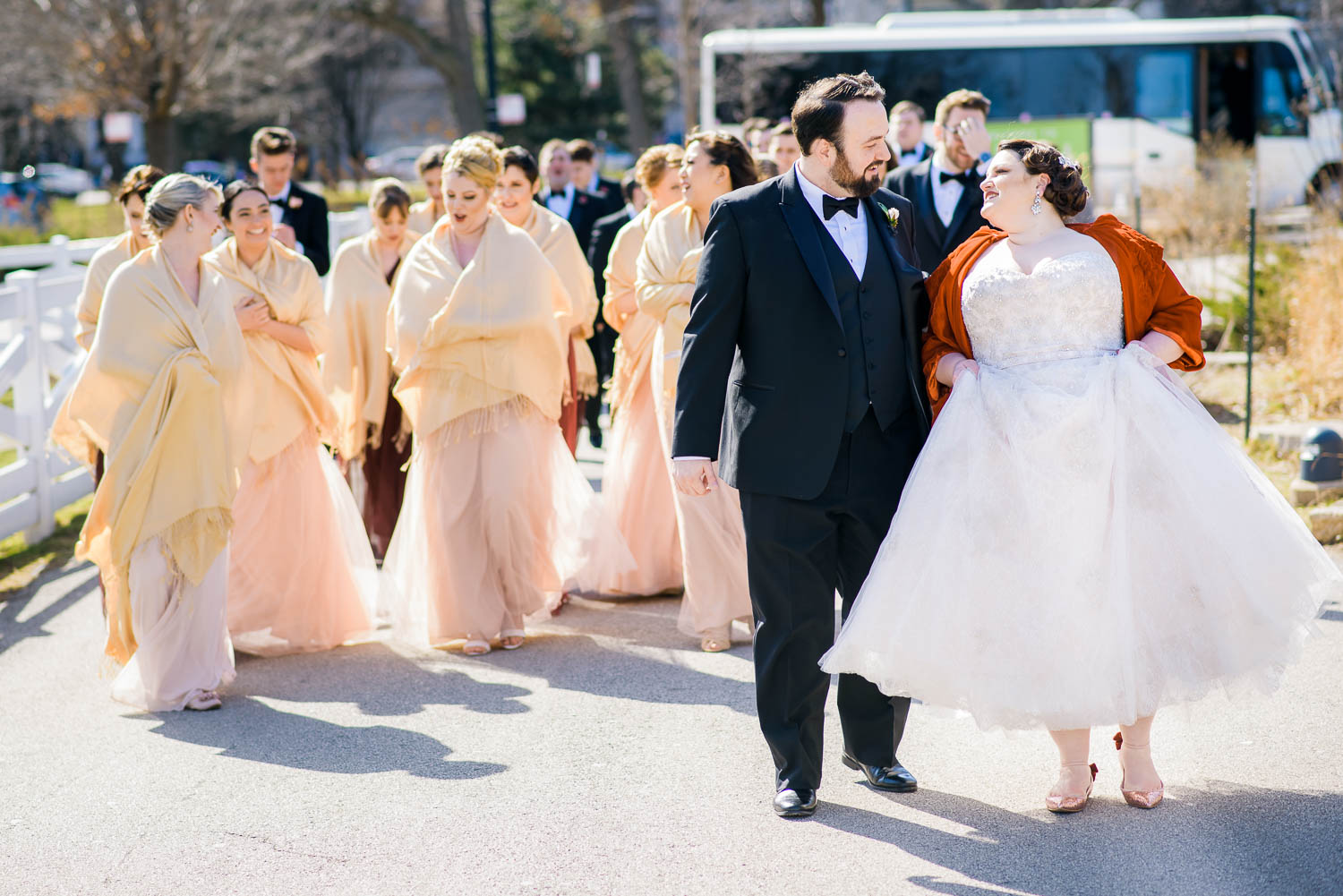Bridal party walks through Lincoln Park during a Chicago wedding at Cafe Brauer.