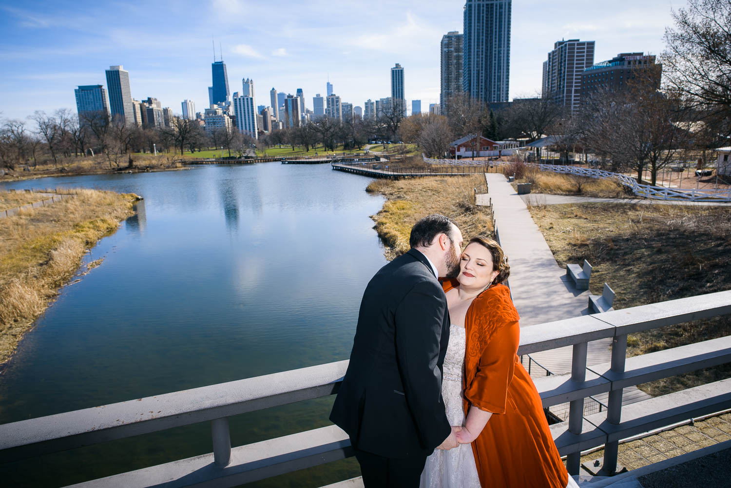 Creative portrait of bride and groom at Lincoln Park before their Cafe Brauer wedding.