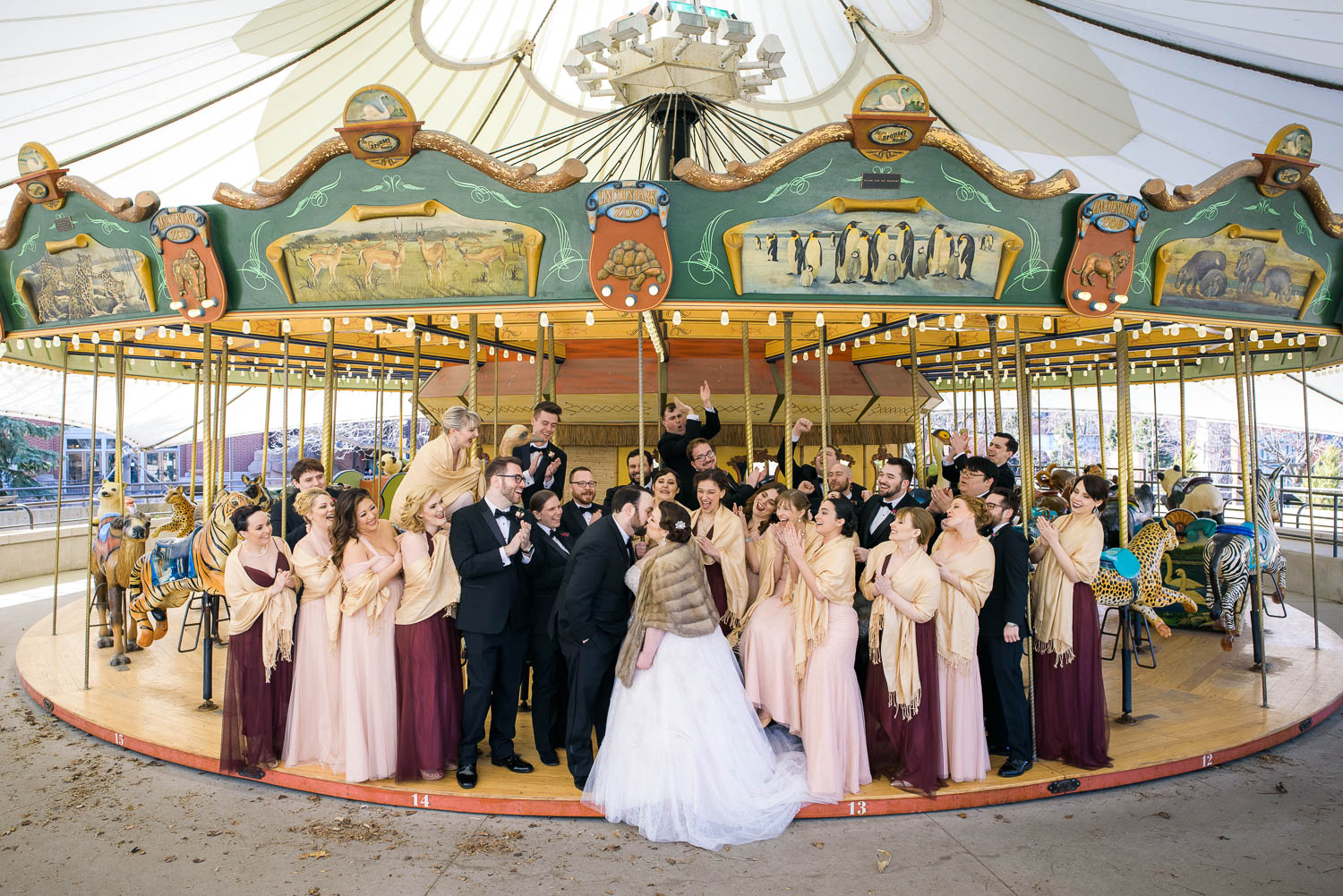 Bridal party portrait at the Lincoln Park Zoo Carousel before their Cafe Brauer wedding.