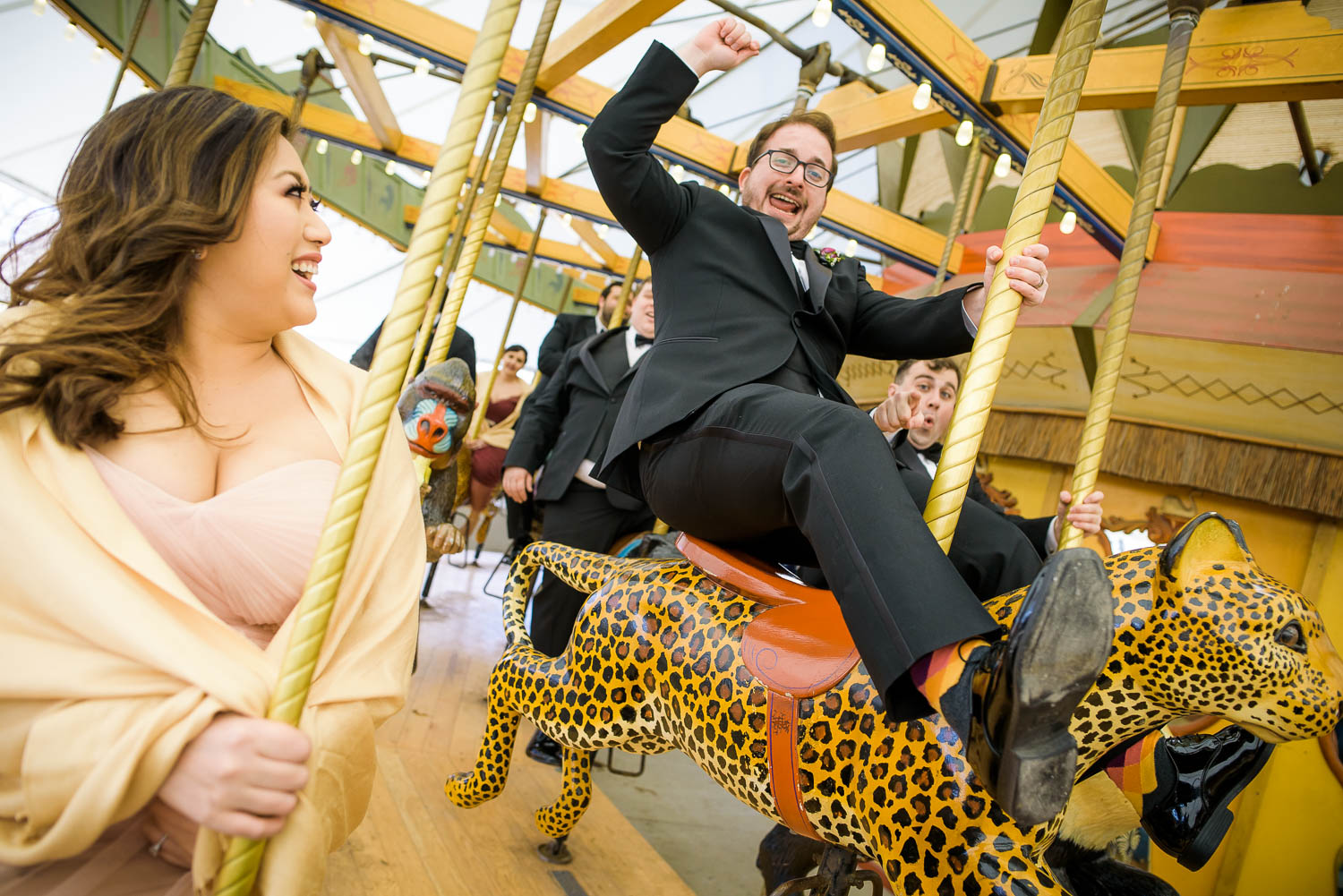 Fun bridal party photo at the Lincoln Park Zoo carousel before their Cafe Brauer wedding.