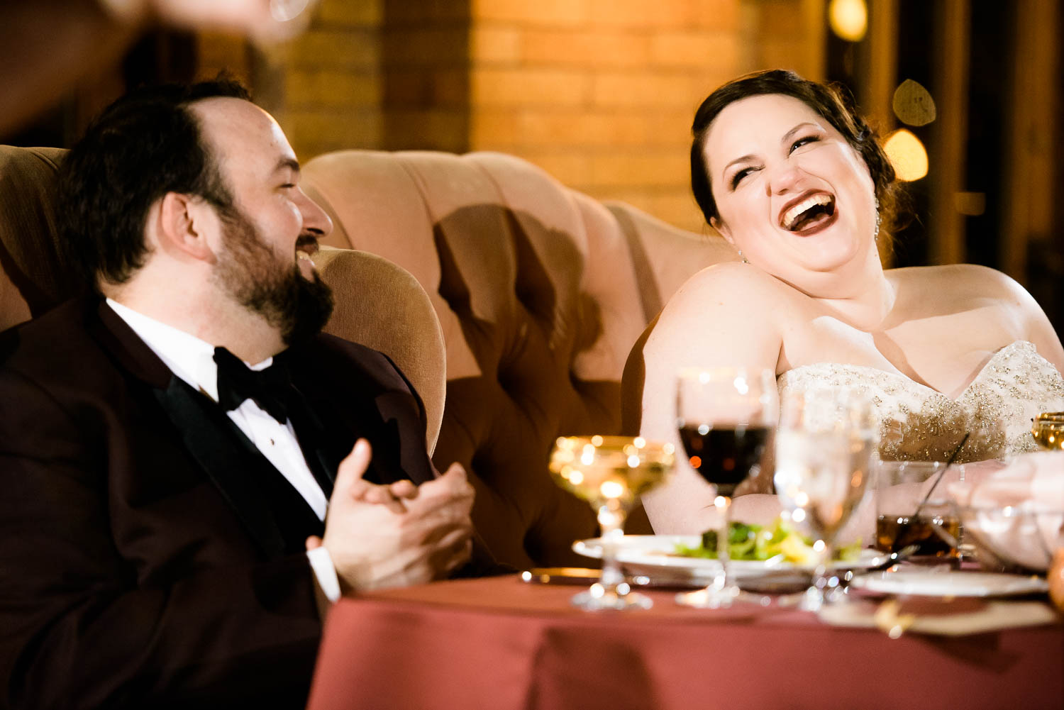 Fun moment of bride and groom during their wedding reception at Cafe Brauer Chicago.
