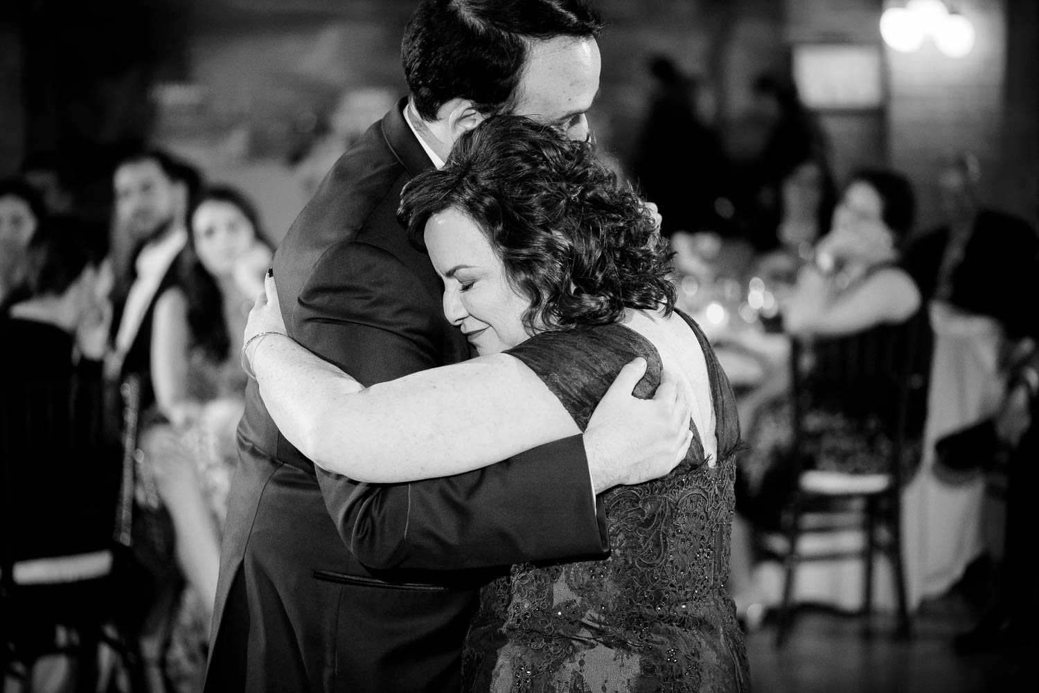 Emotional moment with mother of the groom during a Cafe Brauer Chicago wedding reception.