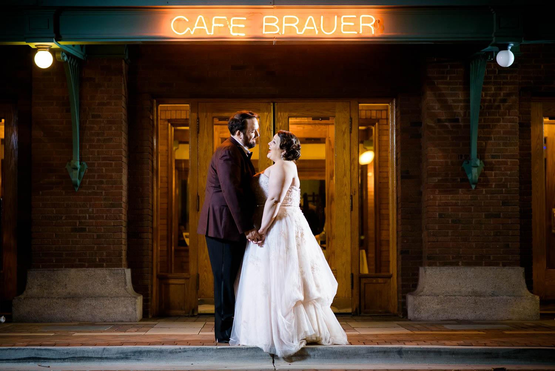 Creative night portrait outside Cafe Brauer Chicago wedding reception.