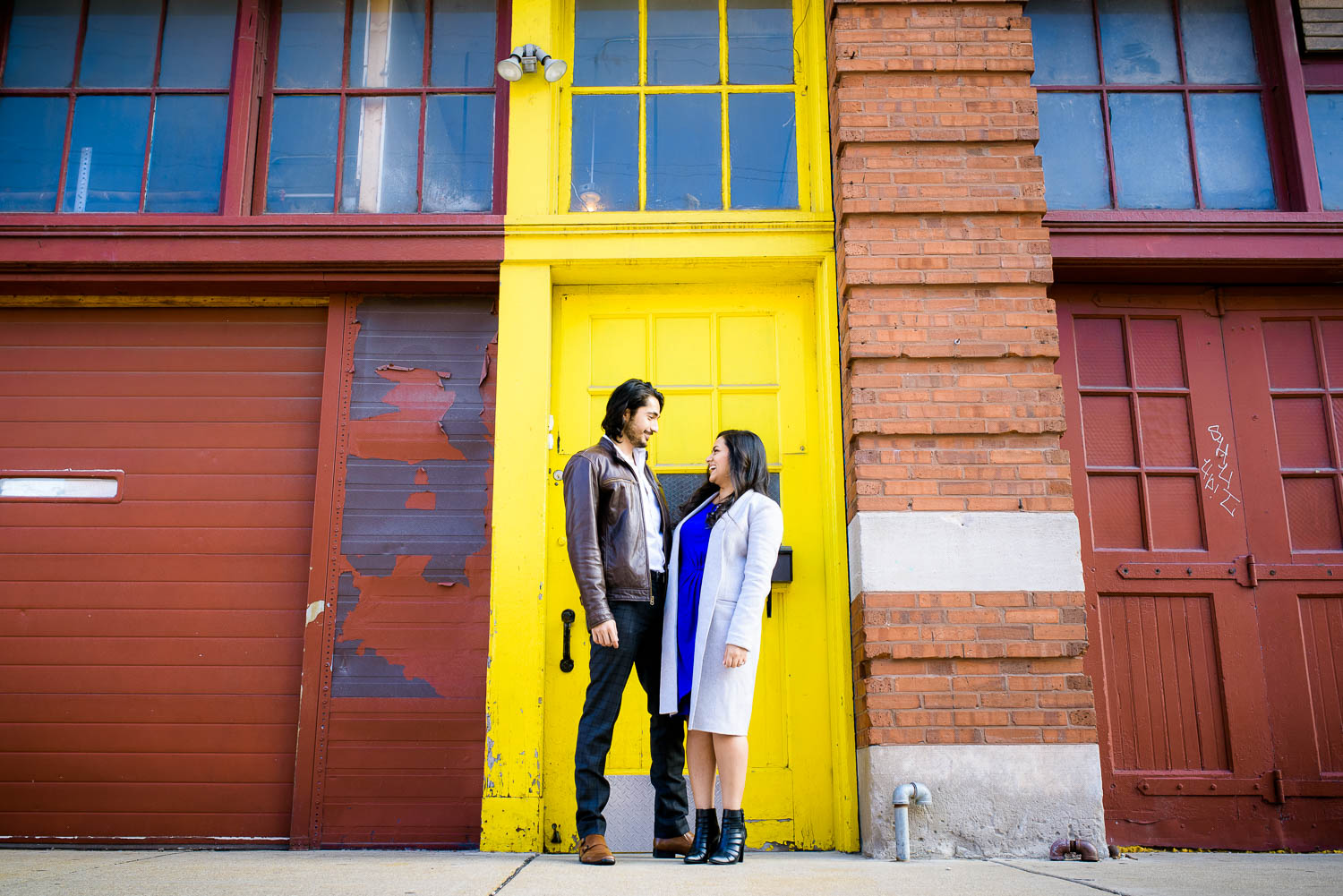Creative, fun, moment-driven engagement photos at the Mars Gallery in Fulton Market Chicago.