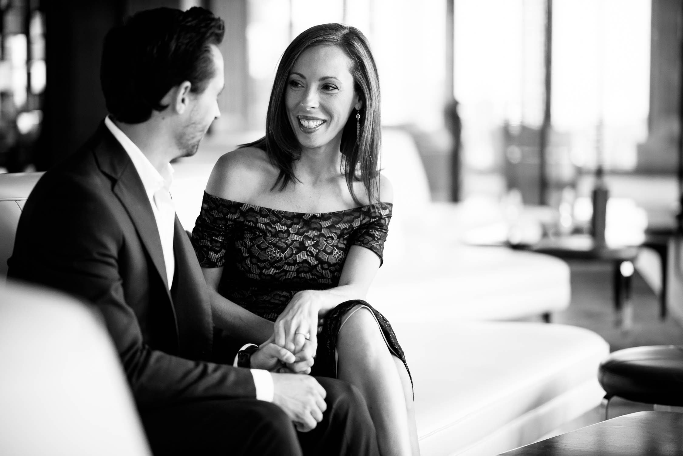 Couple talks over drinks at Travelle inside the Langham Chicago during their engagement session.