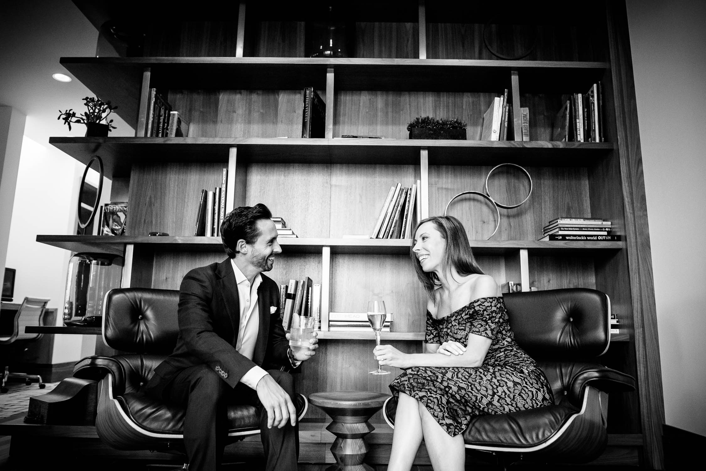 The couple shares a cocktails on the top floor of the Langham Chicago during their engagement session.