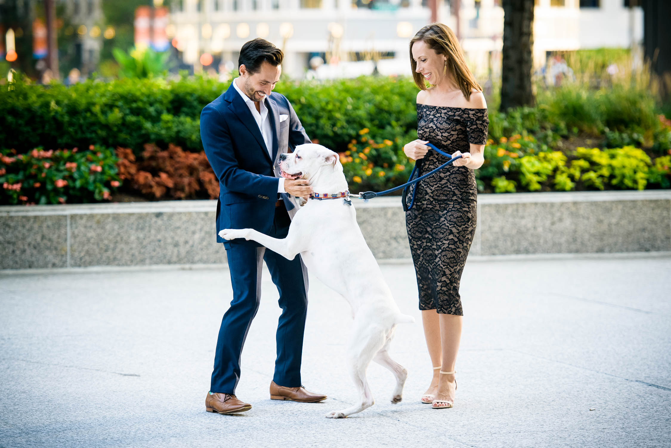 Couple invites their dog on their Chicago riverwalk engagement session.