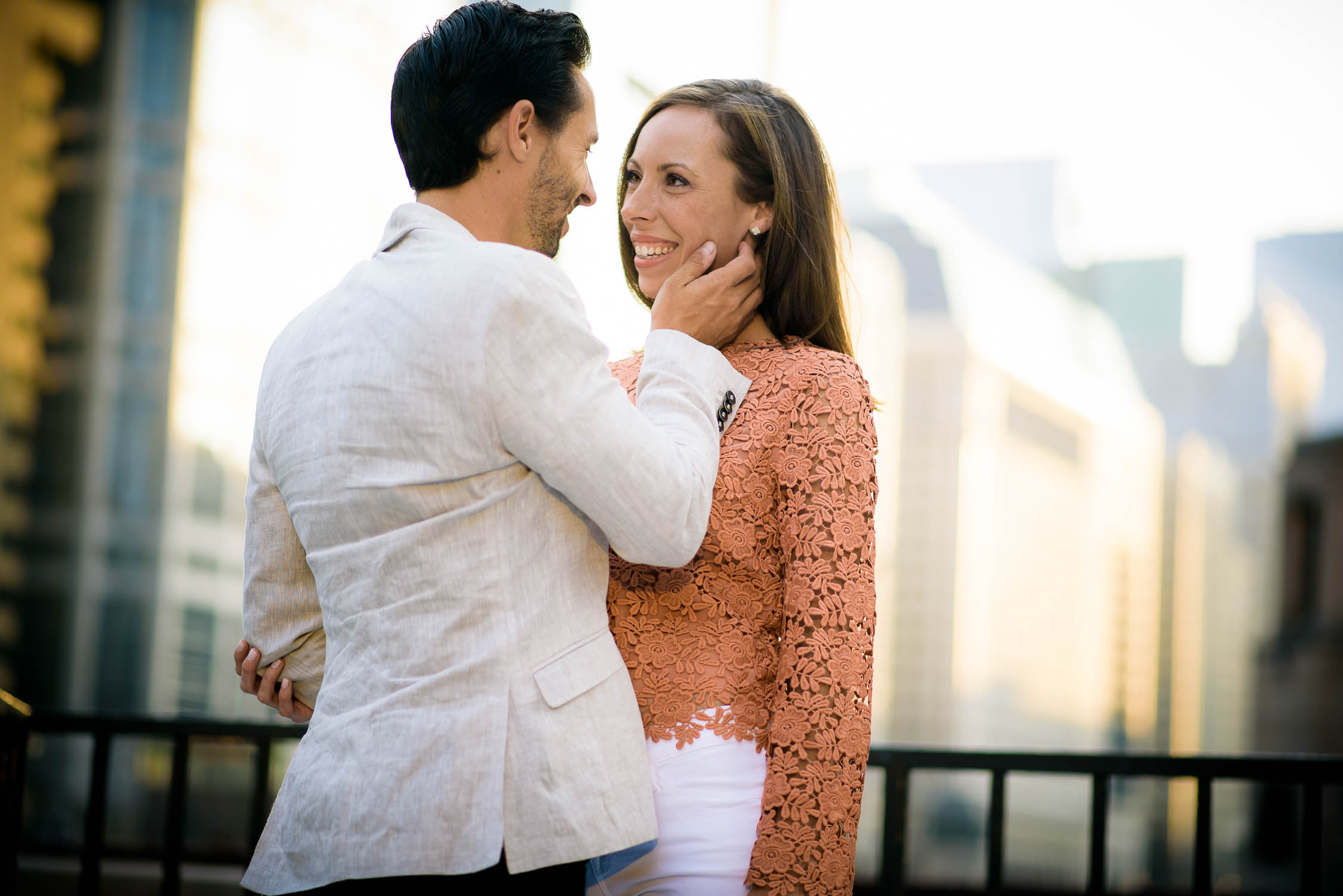 The couple embraces during their Chicago engagement session on the river.