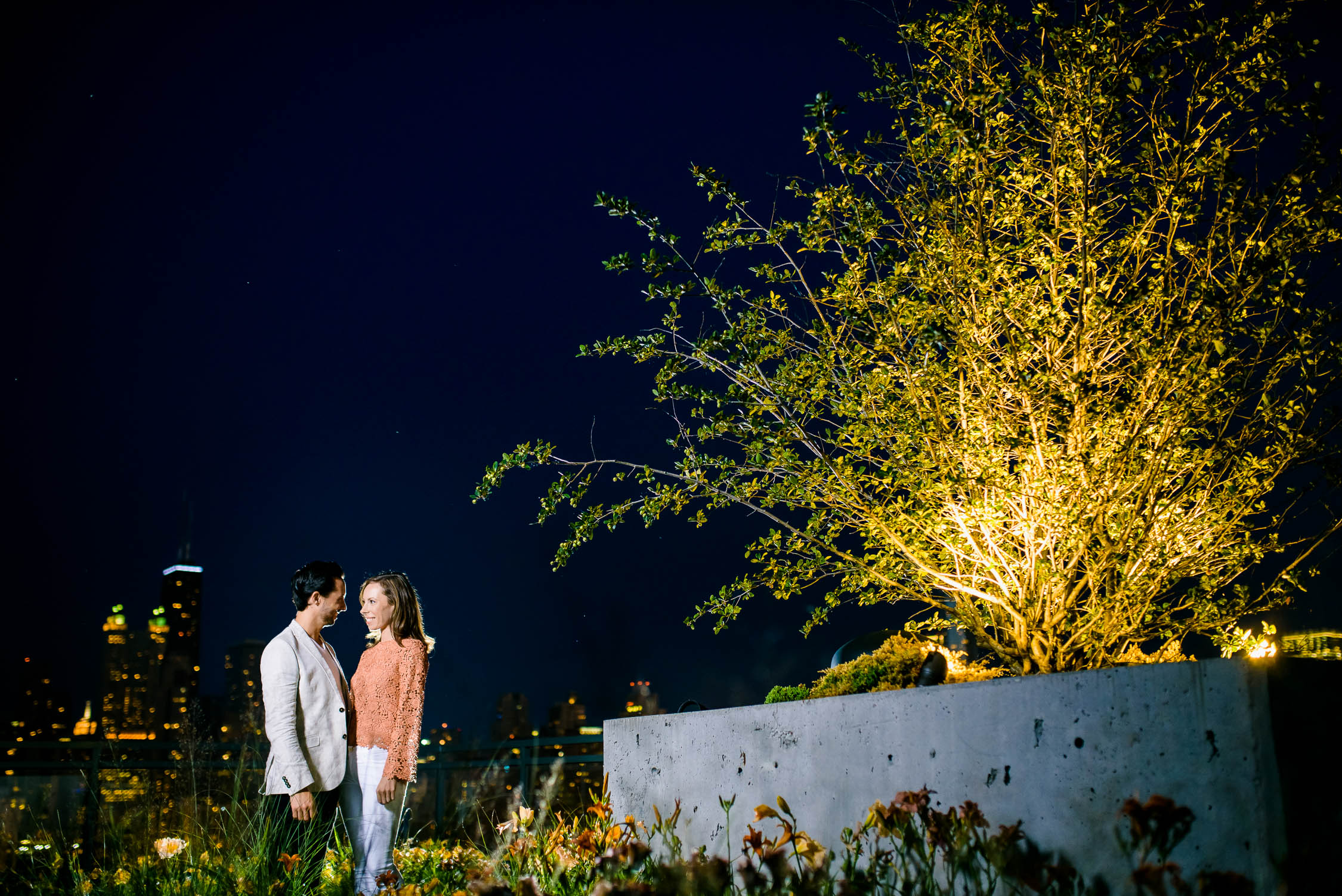 Rooftop night portrait during a Chicago engagement session.