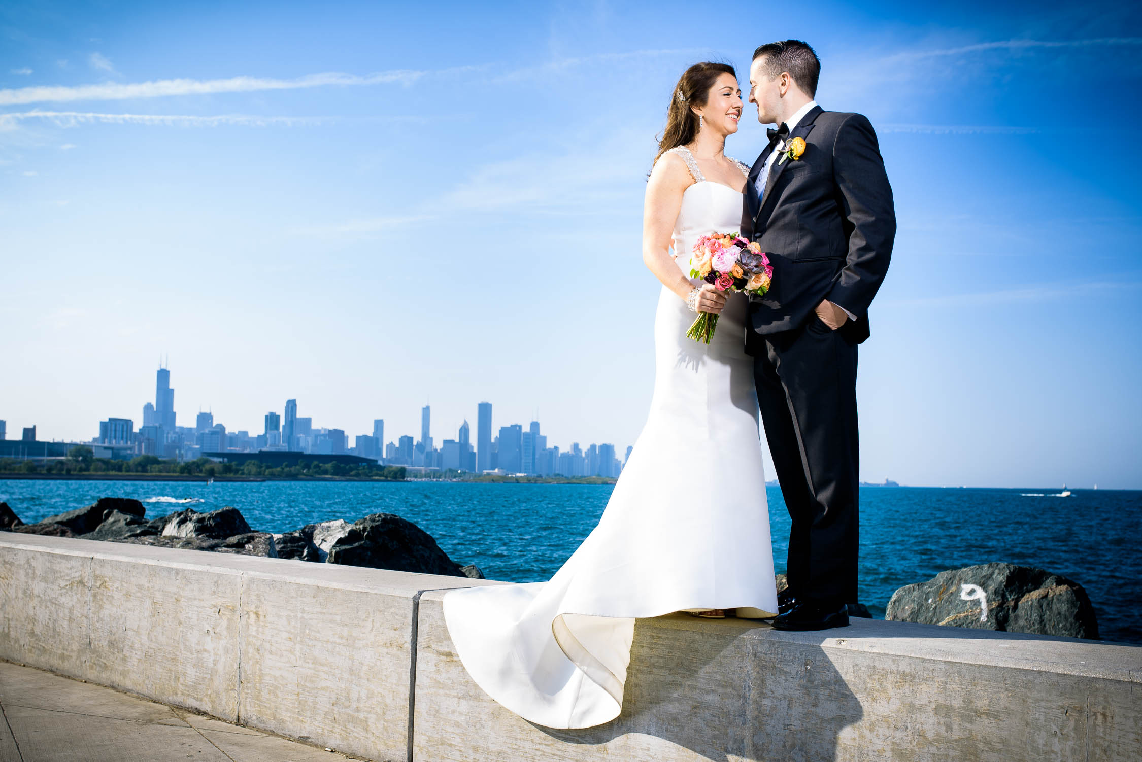 Bride & groom portrait at the 31st Beach with the Chicago skyline before their Bridgeport Art Center wedding.