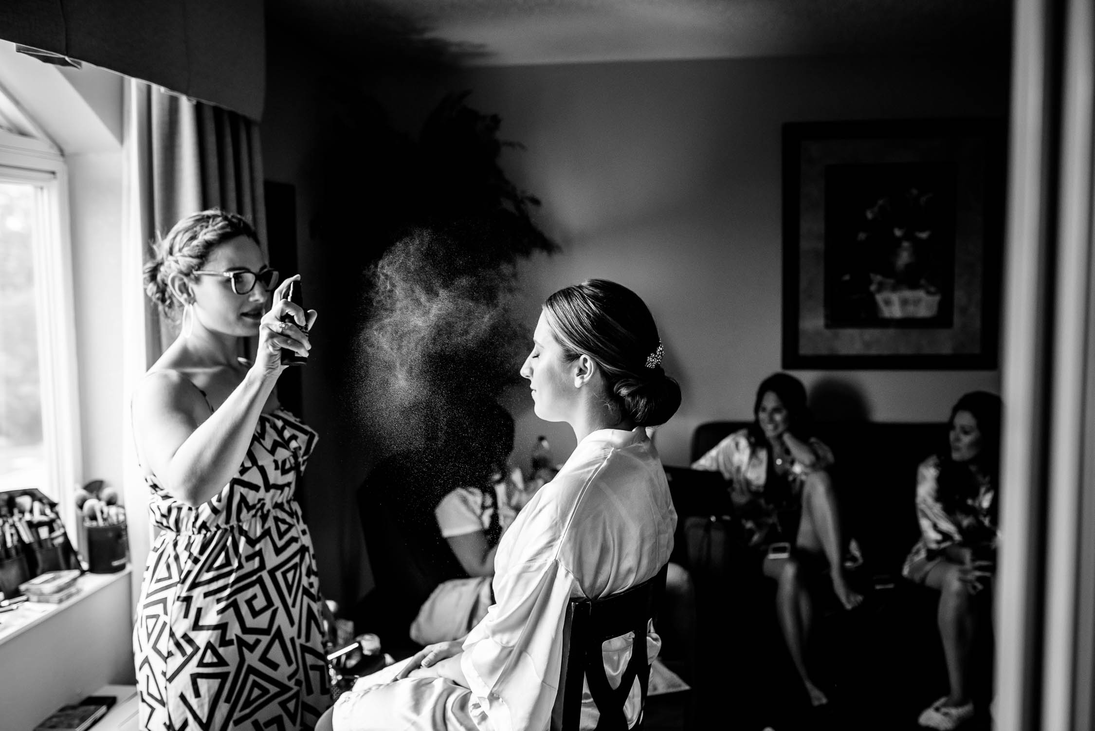 Finishing touches on the bride's makeup before her wedding at Independence Grove in Libertyville.