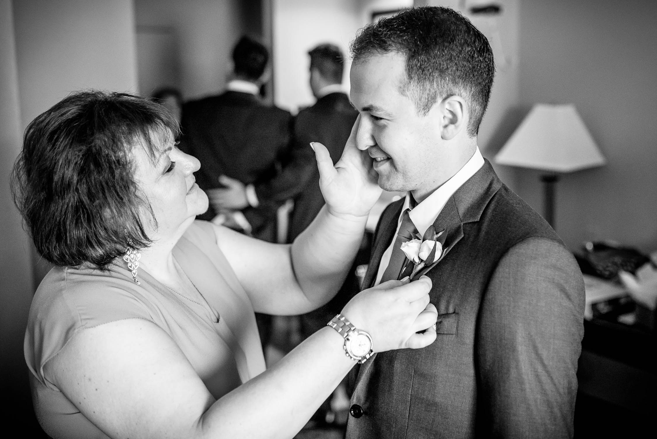 Mother of the groom and her son share a moment together before his wedding at Independence Grove in Libertyville.