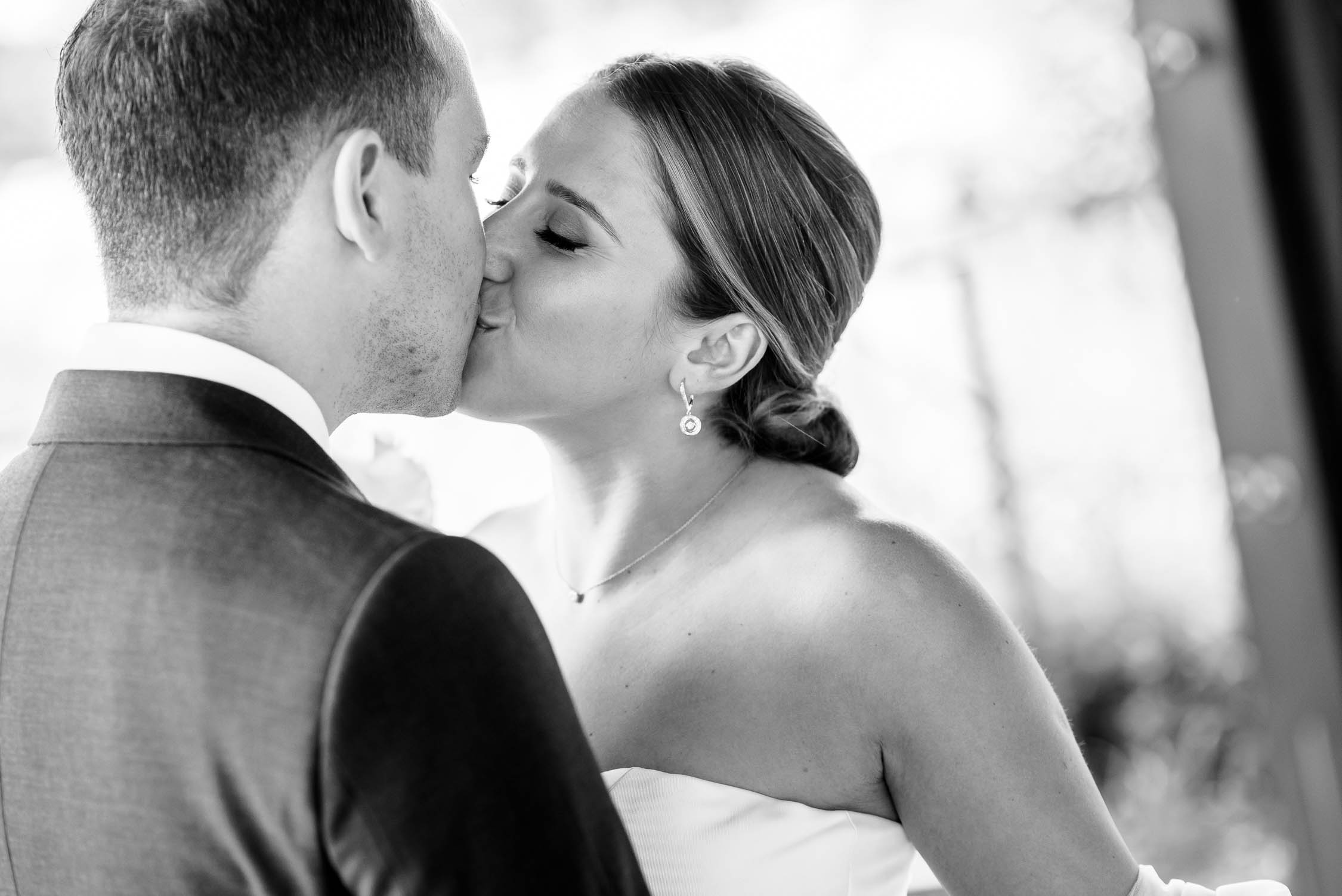 First look and first kiss before their wedding at Independence Grove in Libertyville.