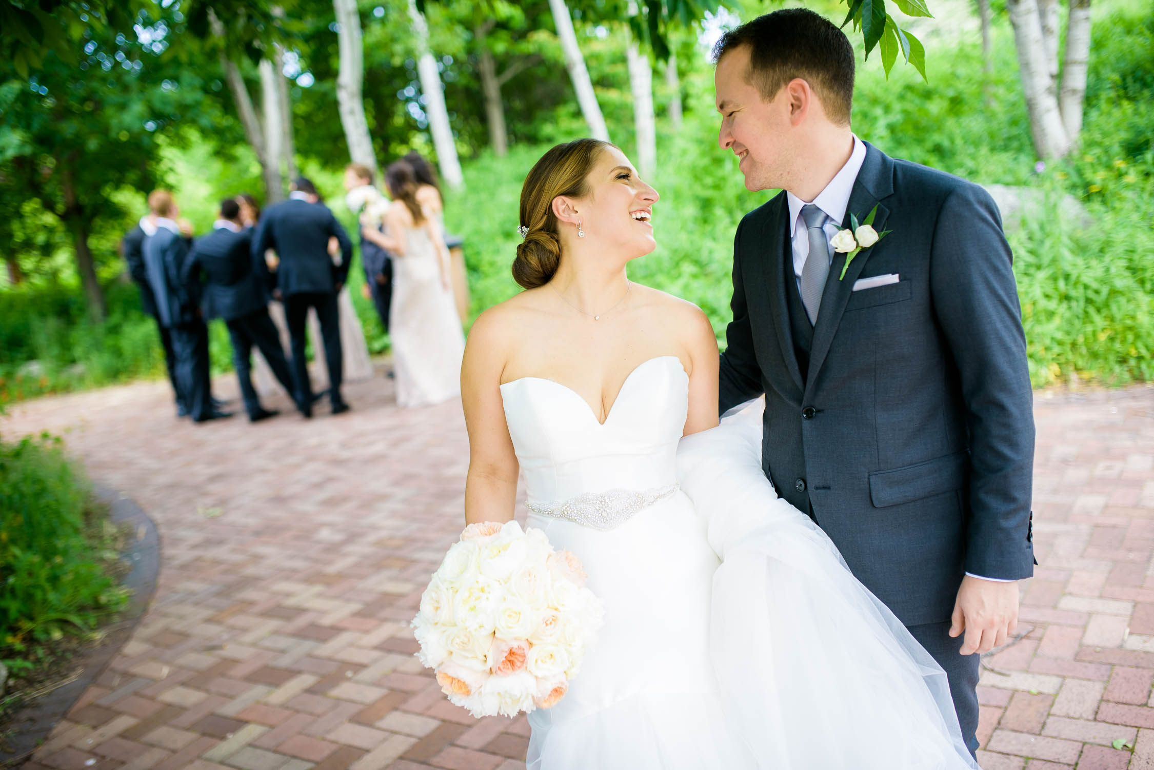 Bride and groom share a laugh together on their wedding day at Independence Grove in Libertyville.