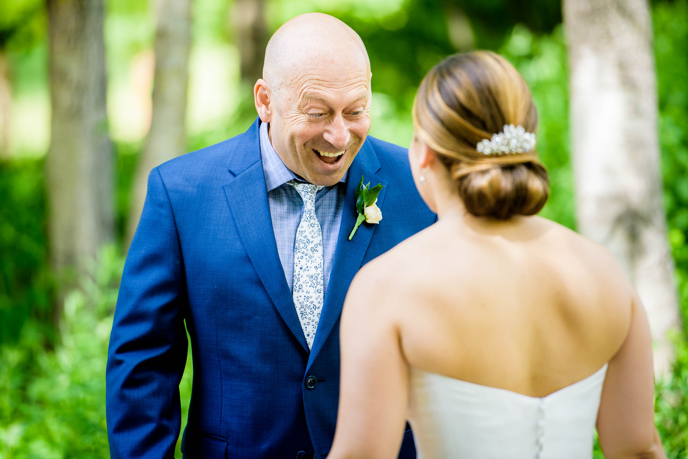 Farther reacts when seeing his daughter for the first time on her wedding day at Independence Grove in Libertyville.
