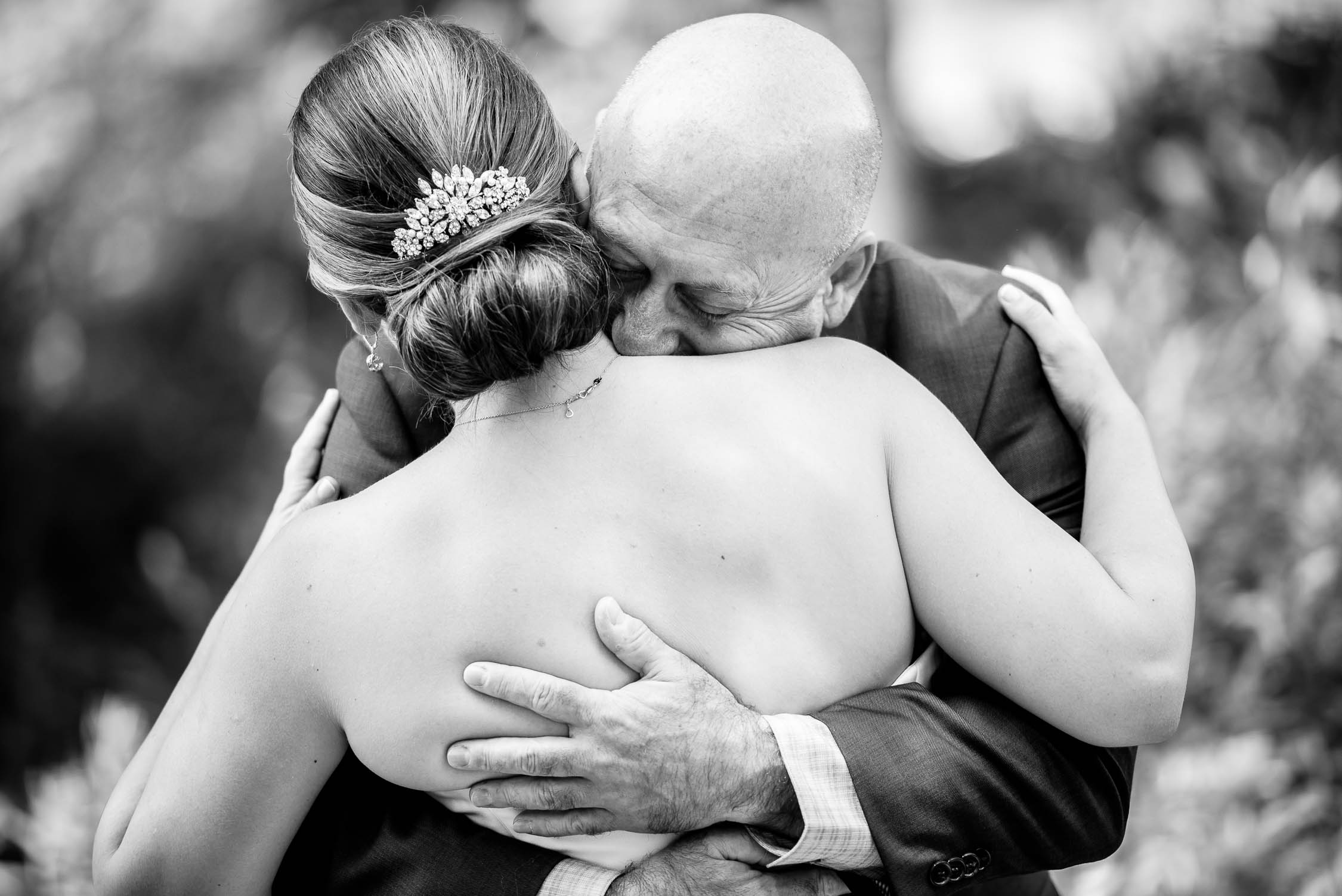 Father embraces the bride on her wedding day at Independence Grove in Libertyville.