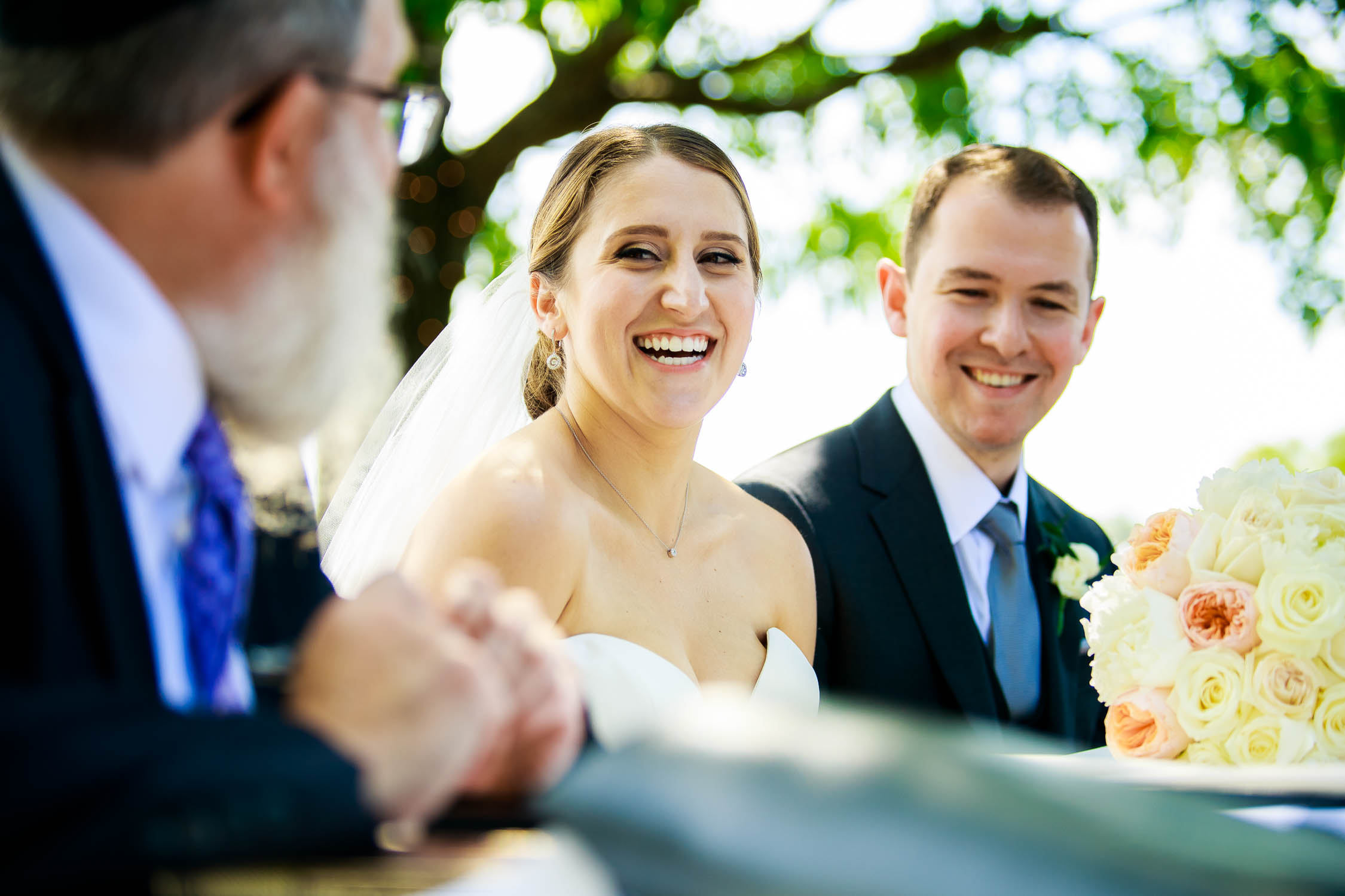 Bride laughs during the ketubah signing at Independence Grove in Libertyville.