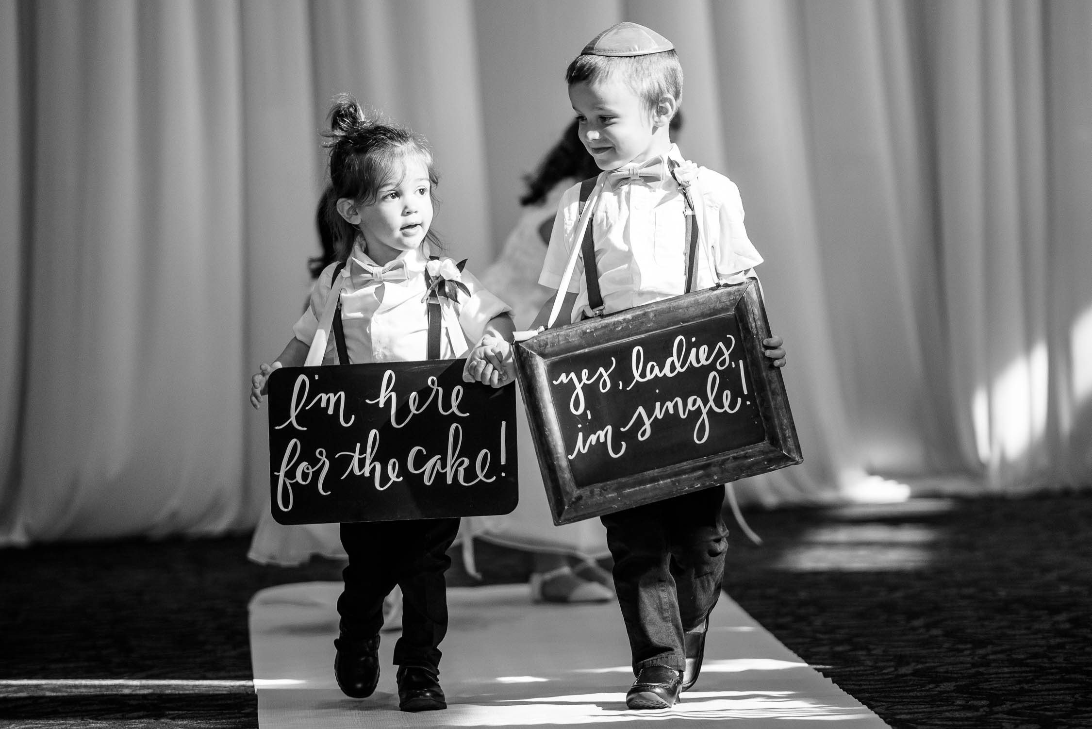 Ring bearers walk down the aisle during a wedding at Independence Grove in Libertyville.