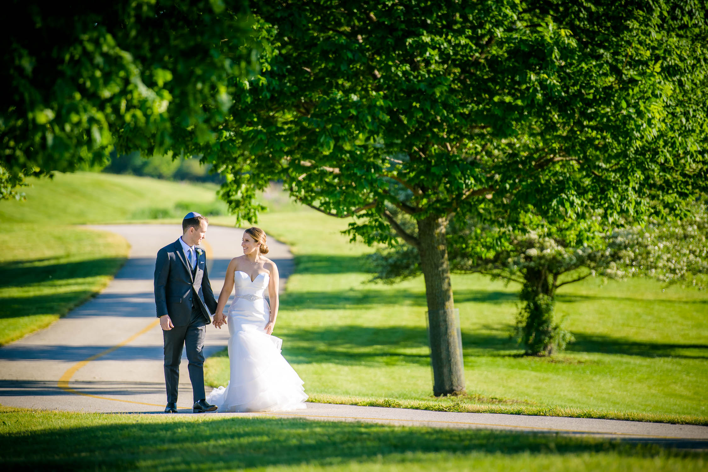 Bride and groom walk together on their wedding day at Independence Grove in Libertyville.