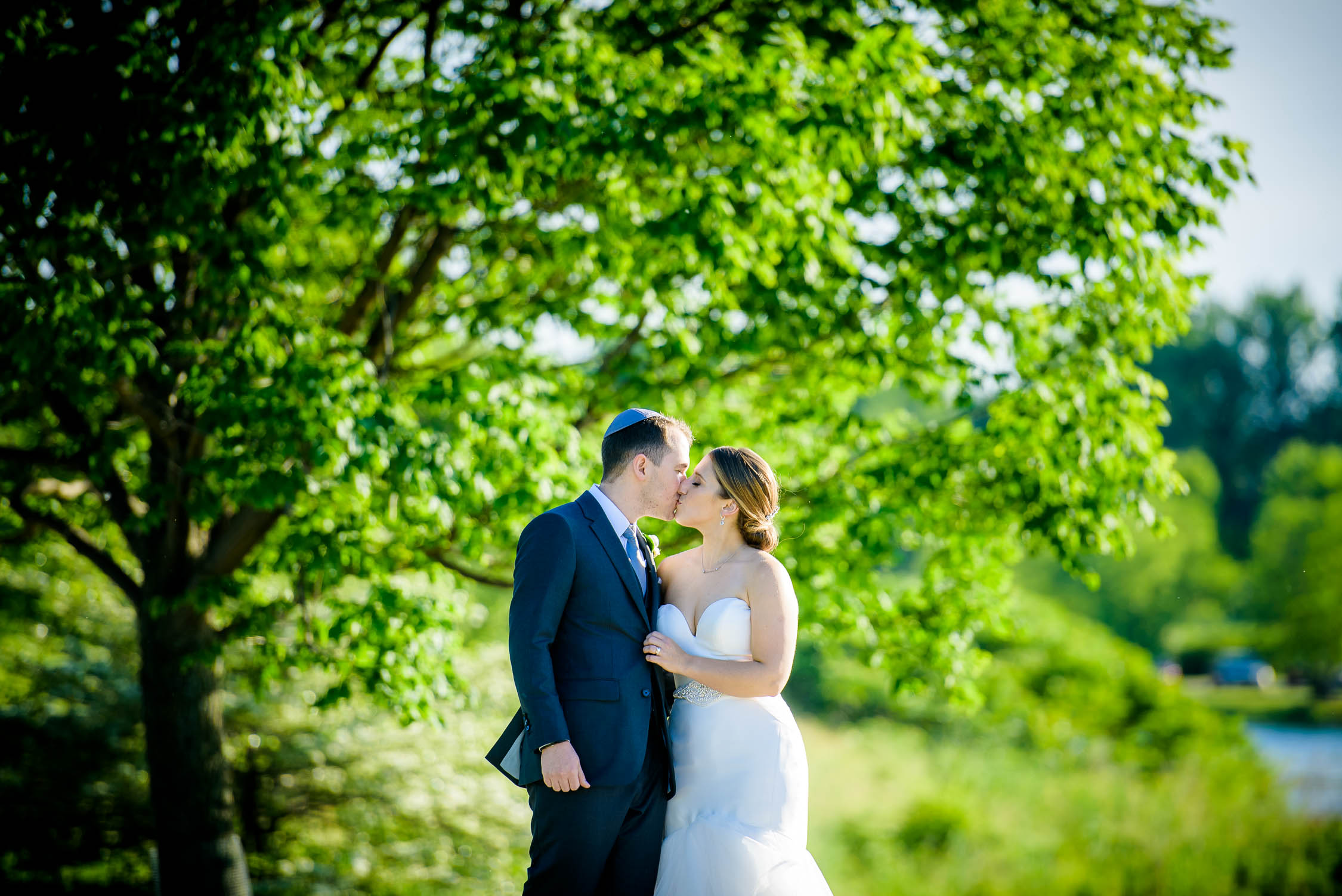 Bride and groom share a kiss on their wedding day at Independence Grove in Libertyville.