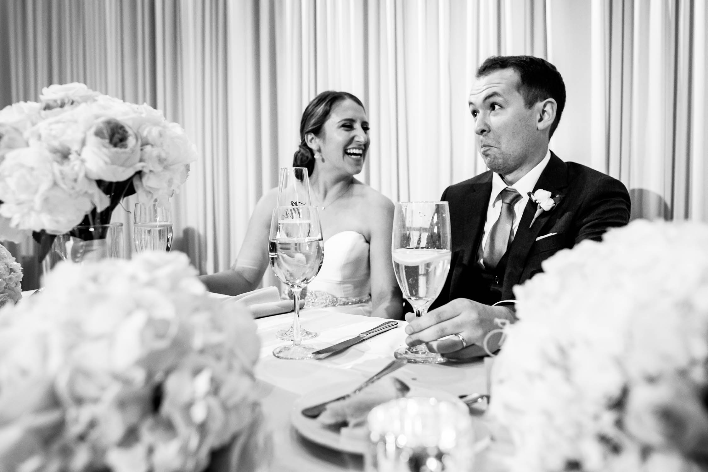 Bride and groom react during speeches at their wedding at Independence Grove in Libertyville.