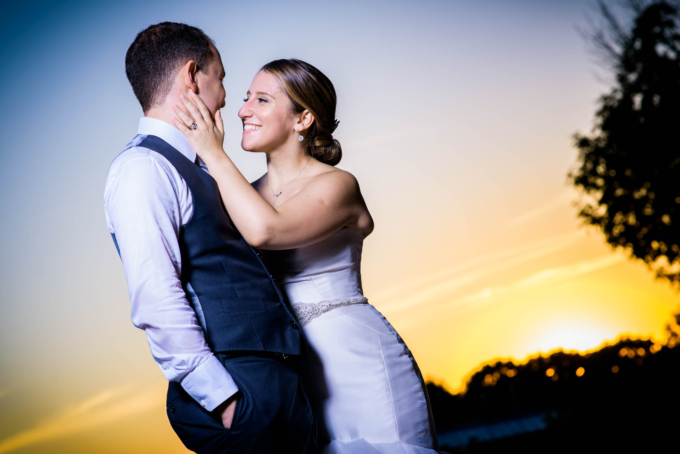 Sunset wedding day portrait of the couple at Independence Grove in Libertyville.