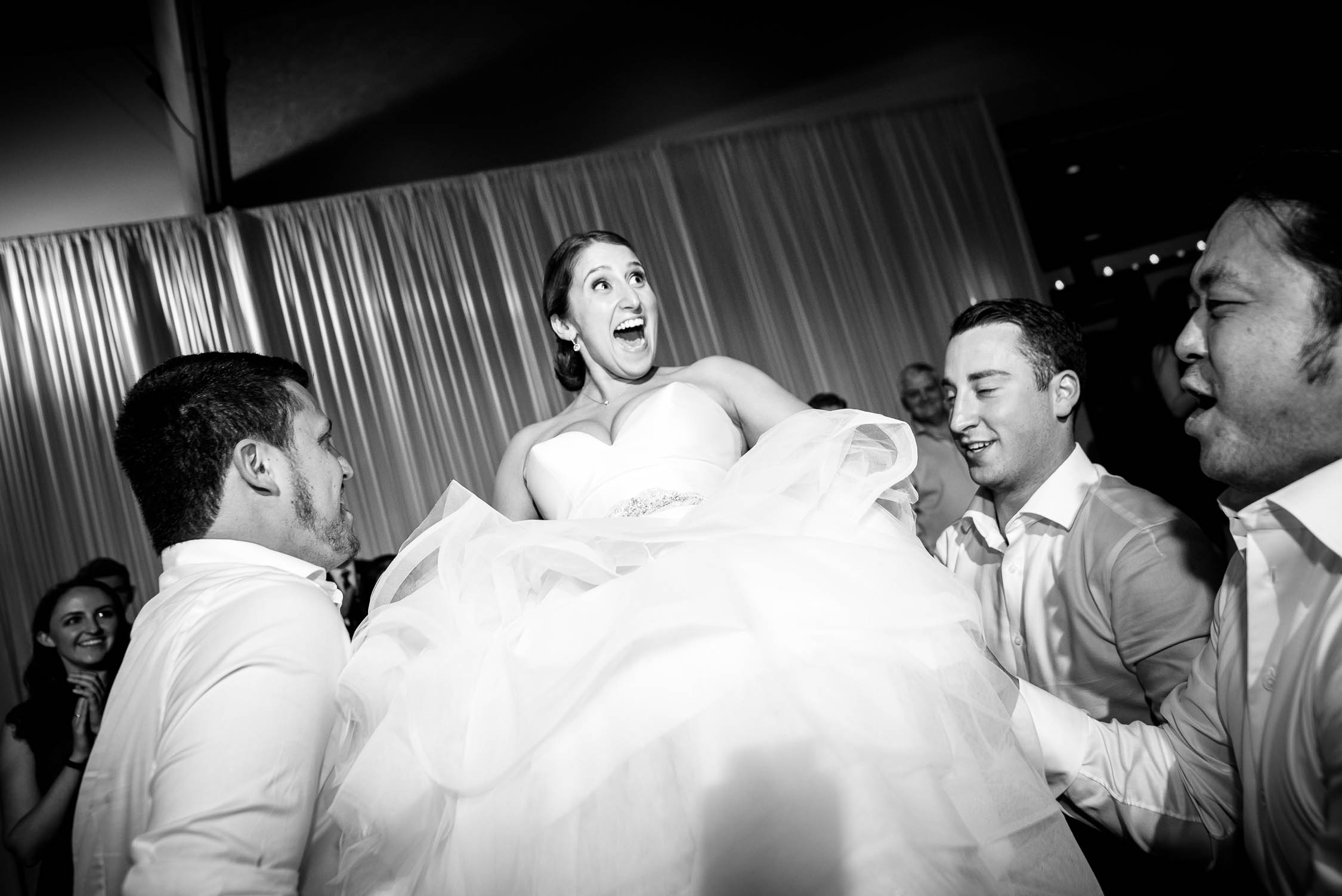 Bride is lifted during the hora at her wedding at Independence Grove in Libertyville.