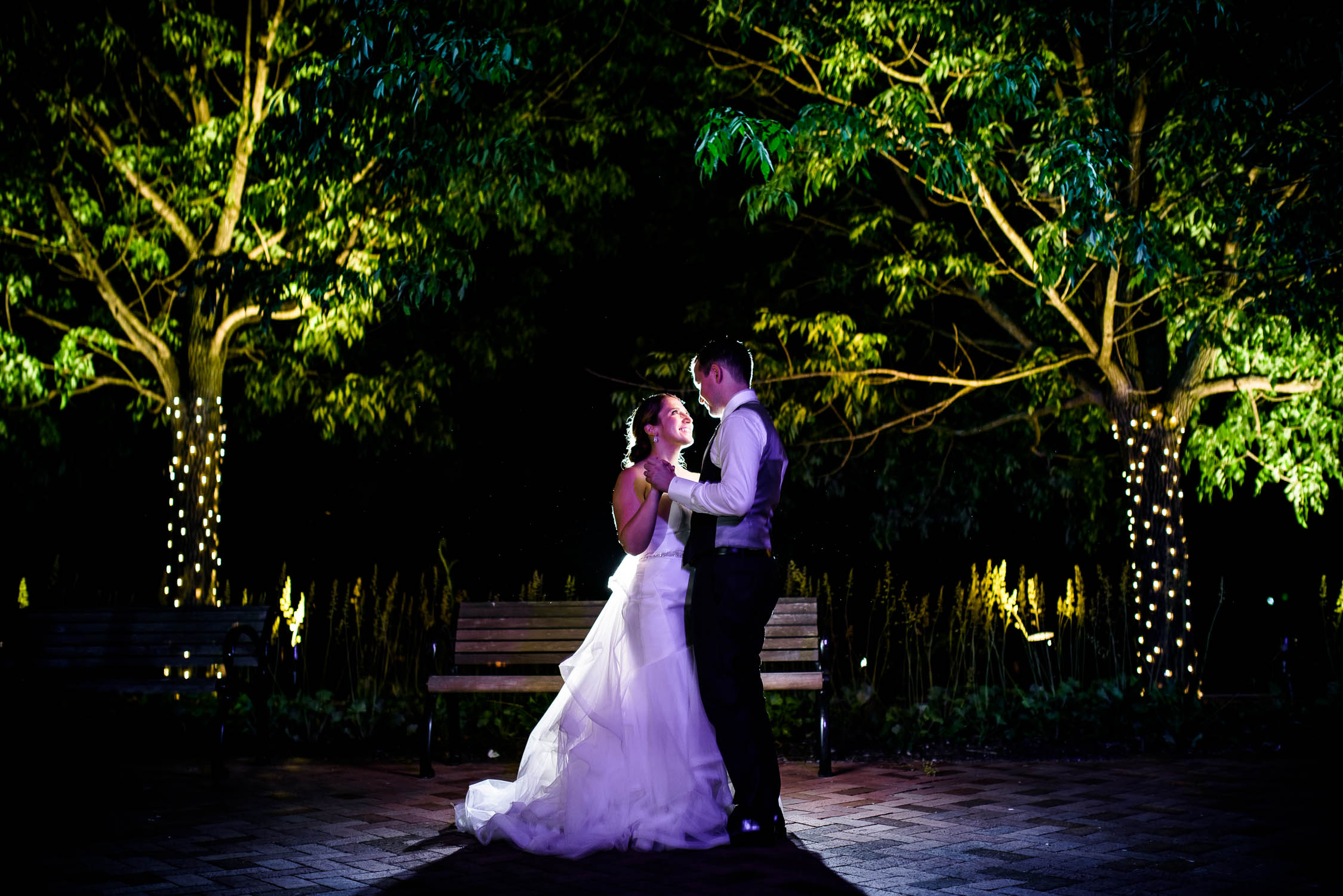 Creative night wedding portrait of the bride and groom at Independence Grove in Libertyville.
