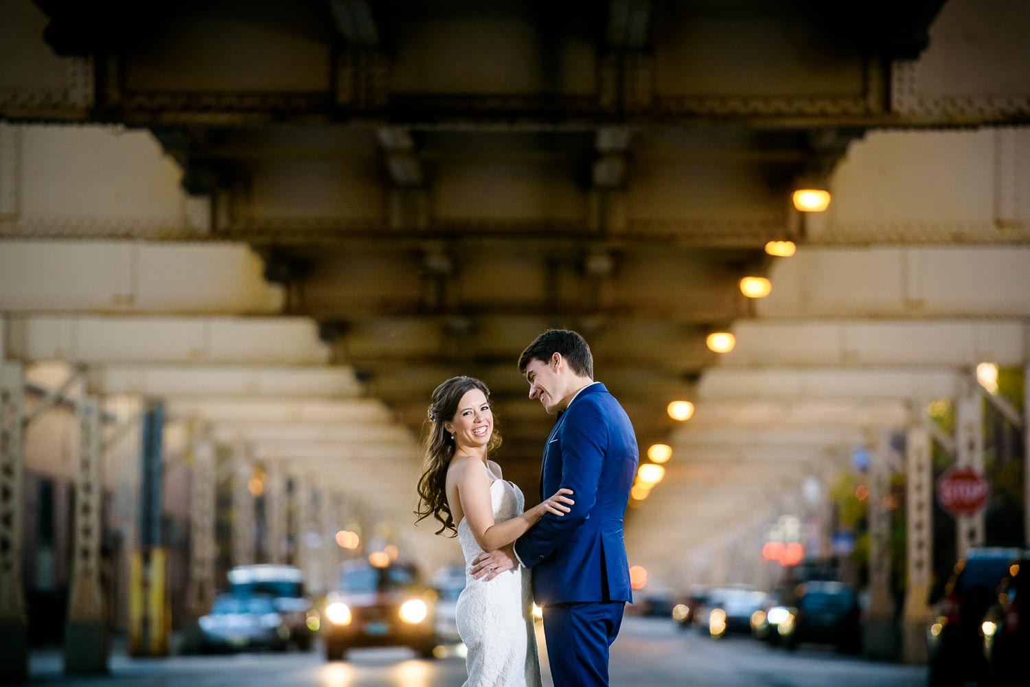 Bride & groom kiss on a bridge over the Chicago River on their wedding day.