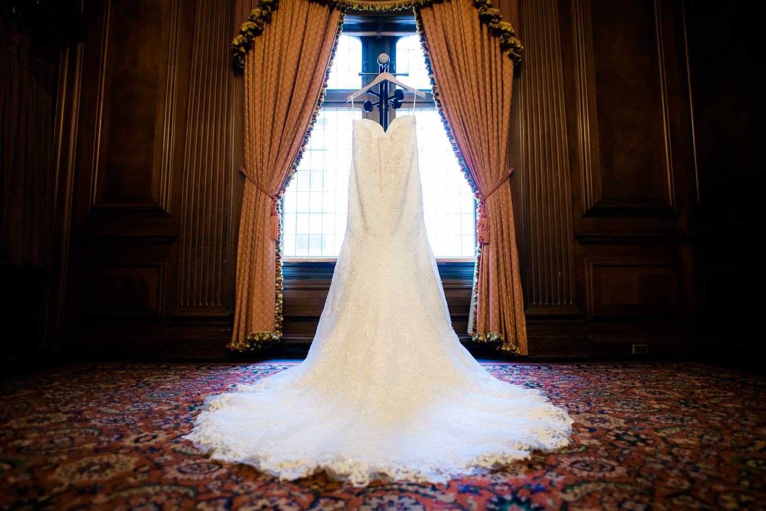 Detail photo of the dress before the couple's University Club of Chicago wedding.