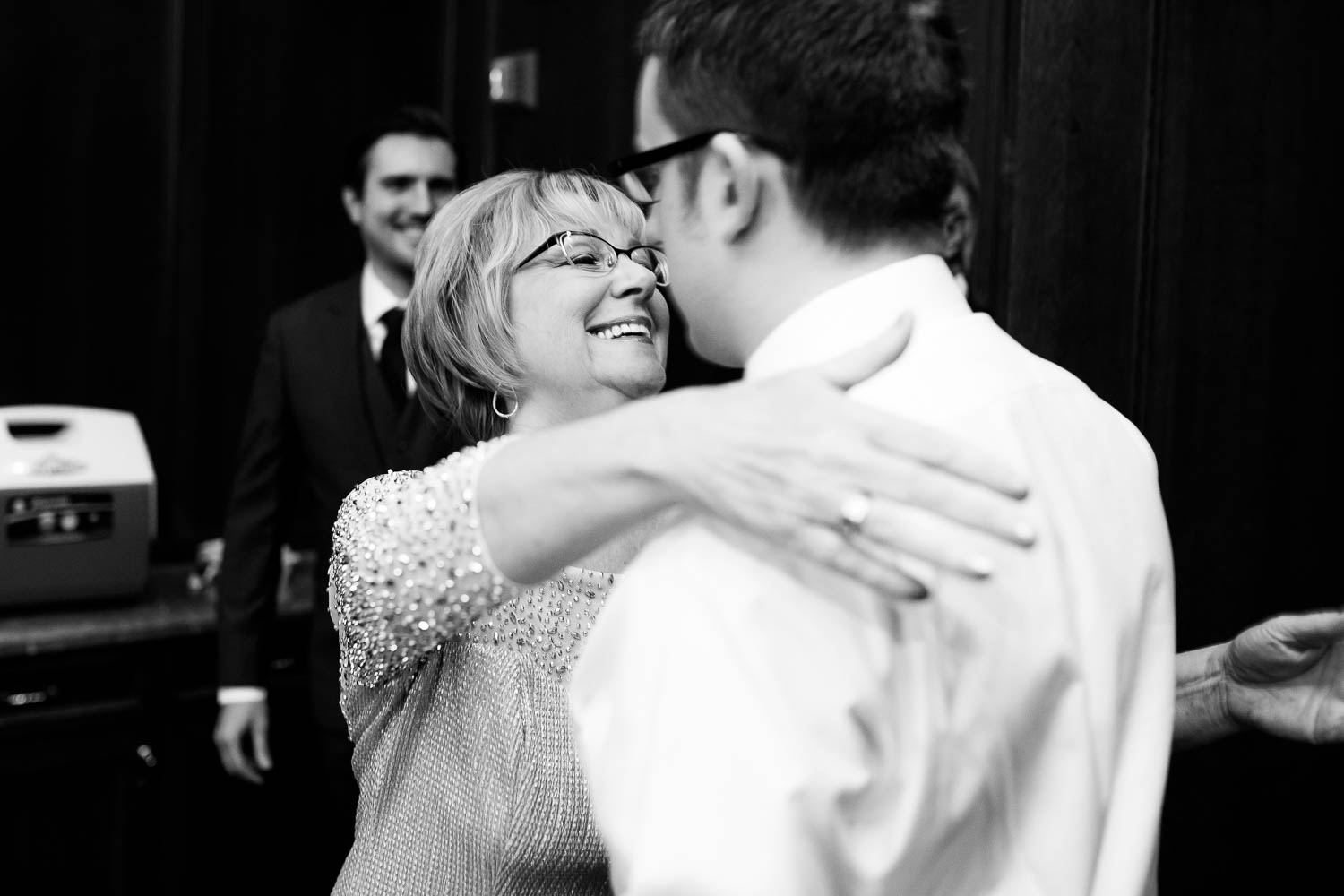 Mother and son hug before his University Club of Chicago wedding.