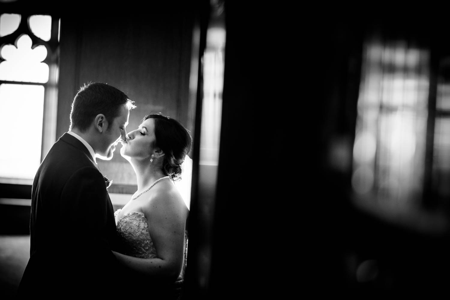 Bride and groom kiss during their University Club of Chicago wedding.