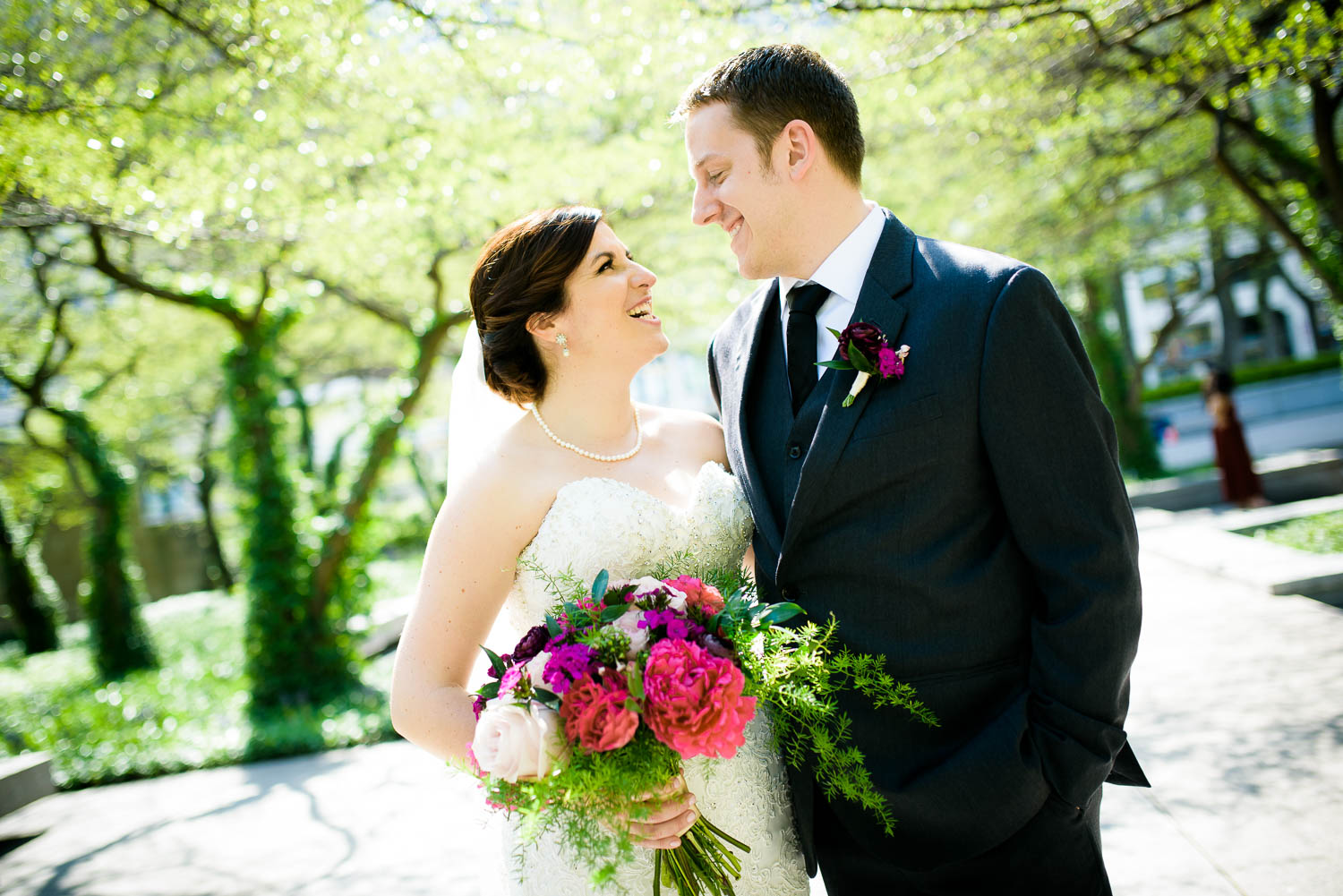 Bride and groom share a laugh at the Art Institute South Gardens Chicago.