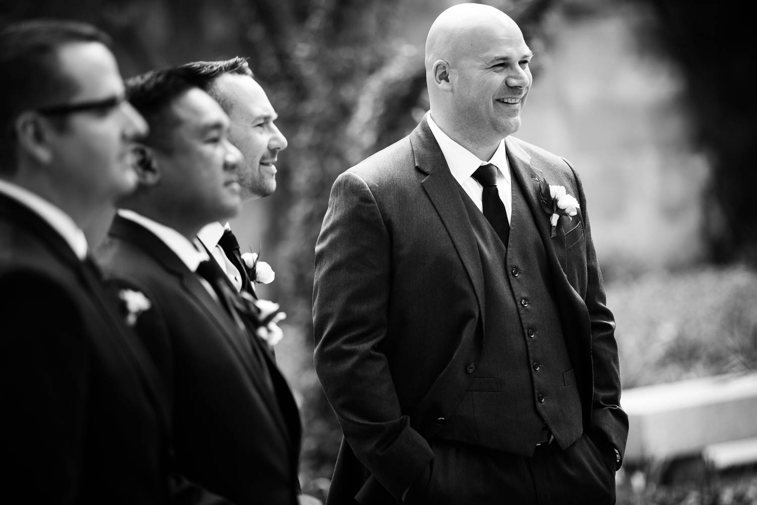 Groomsmen during a Chicago wedding at the Art Institute South Gardens.