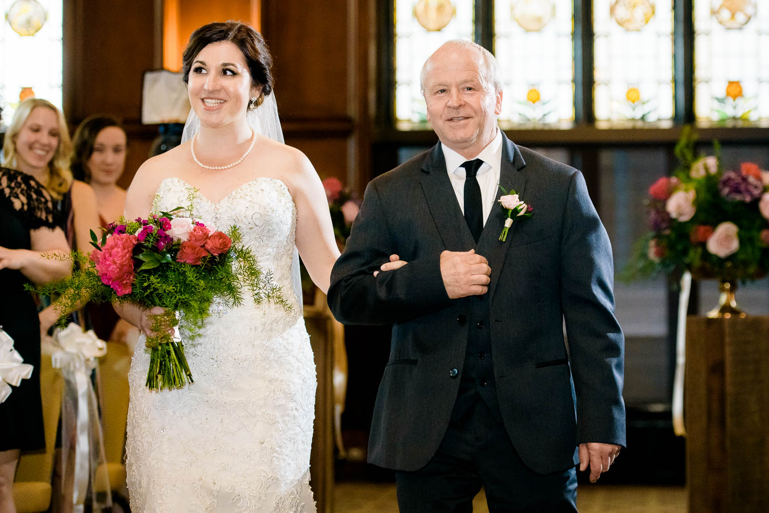 Father and bride walk down the aisle during a University Club of Chicago wedding.