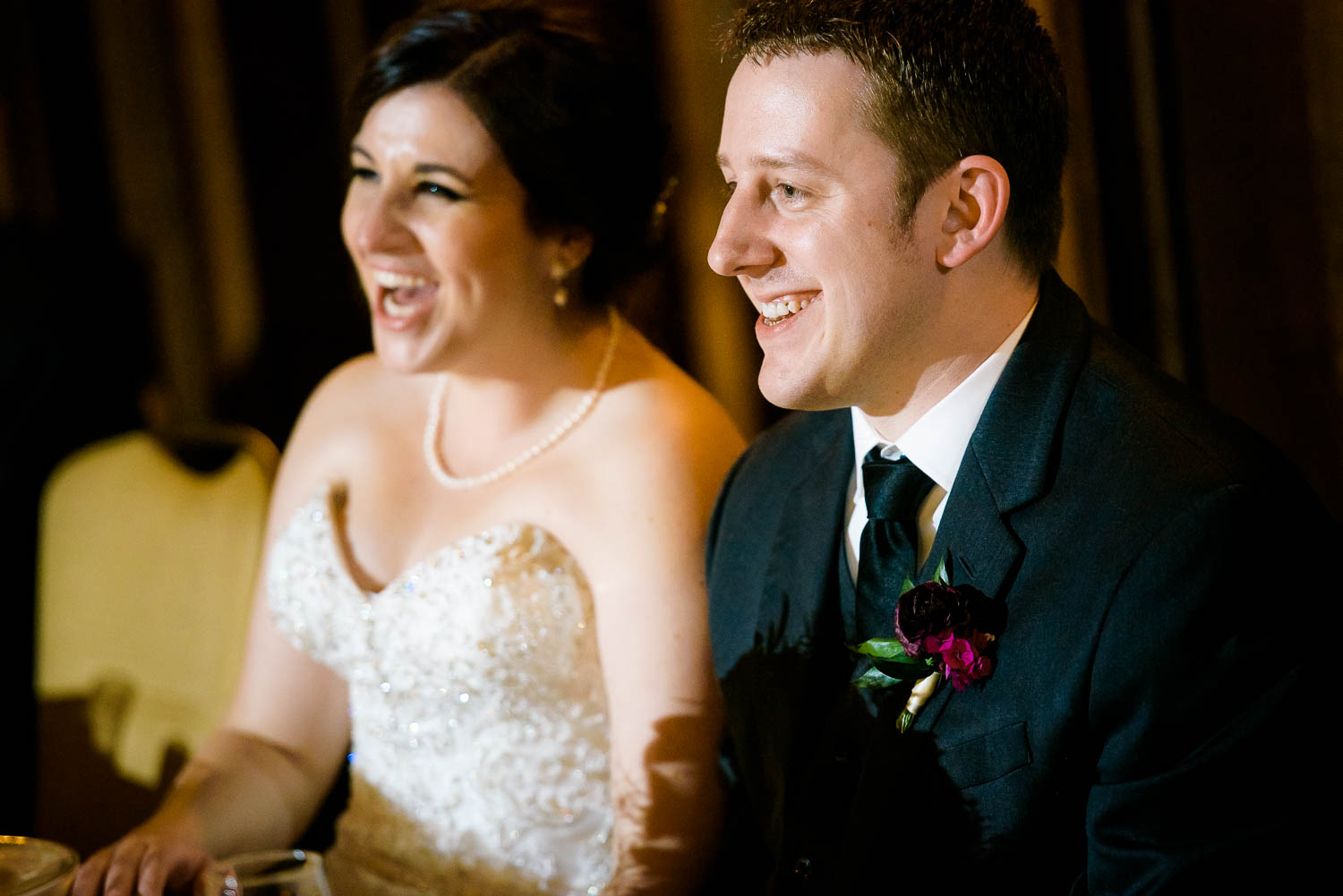 Couple laughs during their wedding party speeches during a University Club of Chicago wedding.