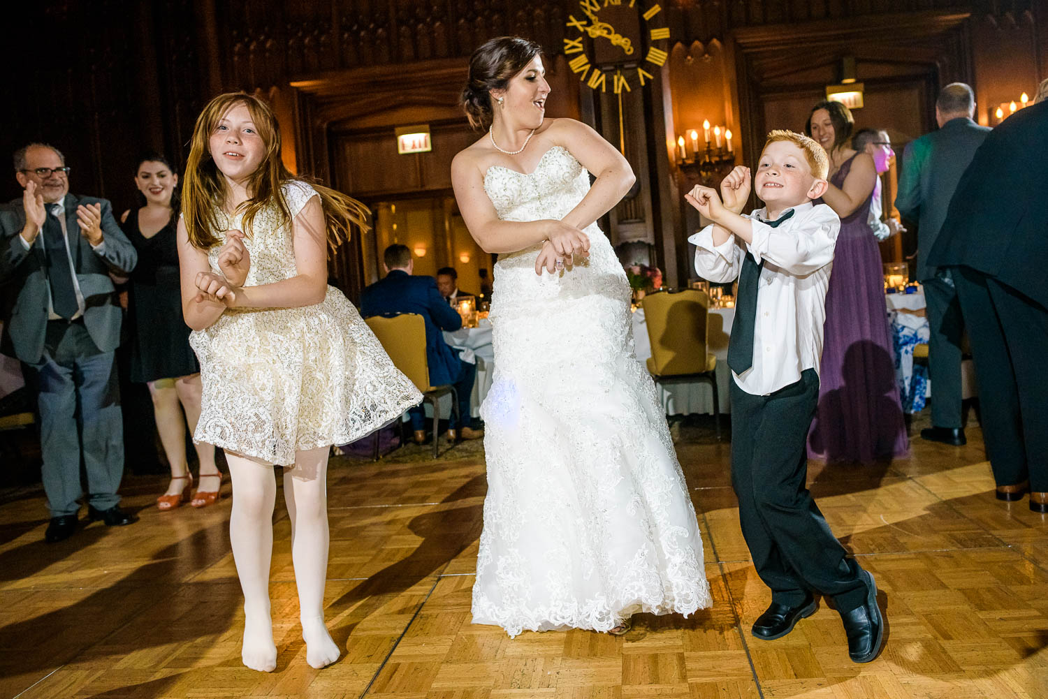 Bride dances with the flower girl and ring bearer during a University Club of Chicago wedding.