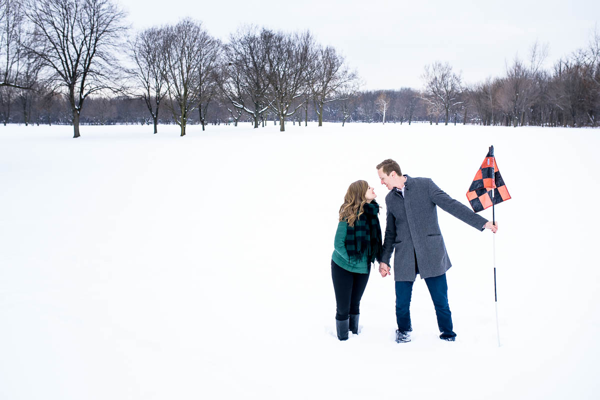 Lawrence & Katie joy embrace during their Chicago winter engagement session at Billy Caldwell Golf Course.