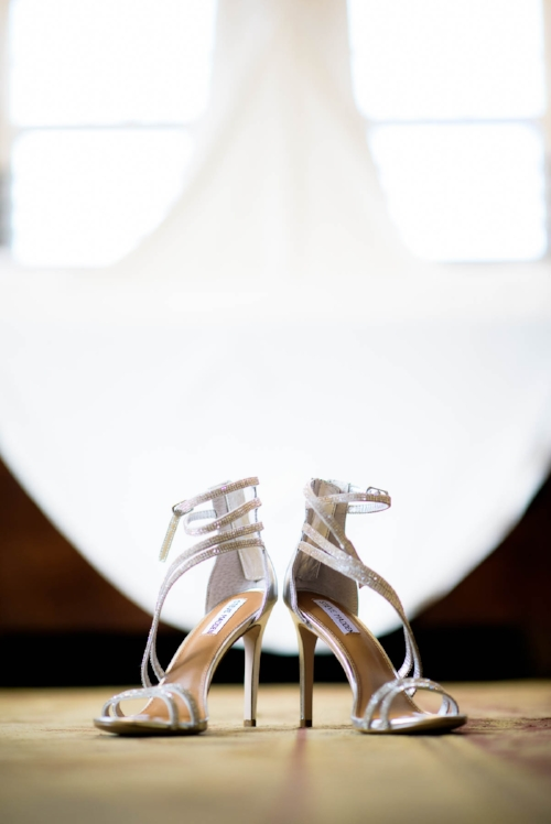 Bride's shoes detail photo during her wedding at the Manor House in Littleton, Colorado.