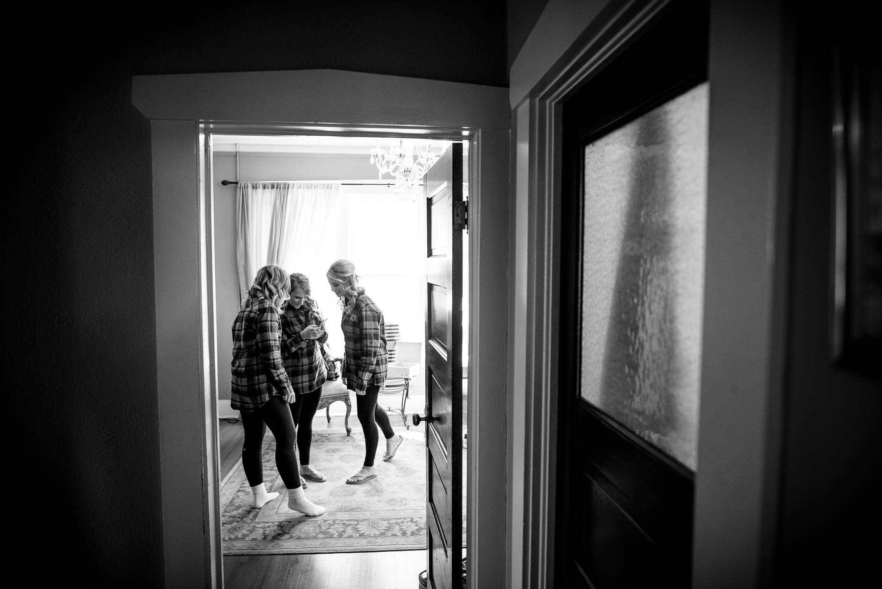 Bridesmaids getting ready during a wedding at the Manor House in Littleton, Colorado.
