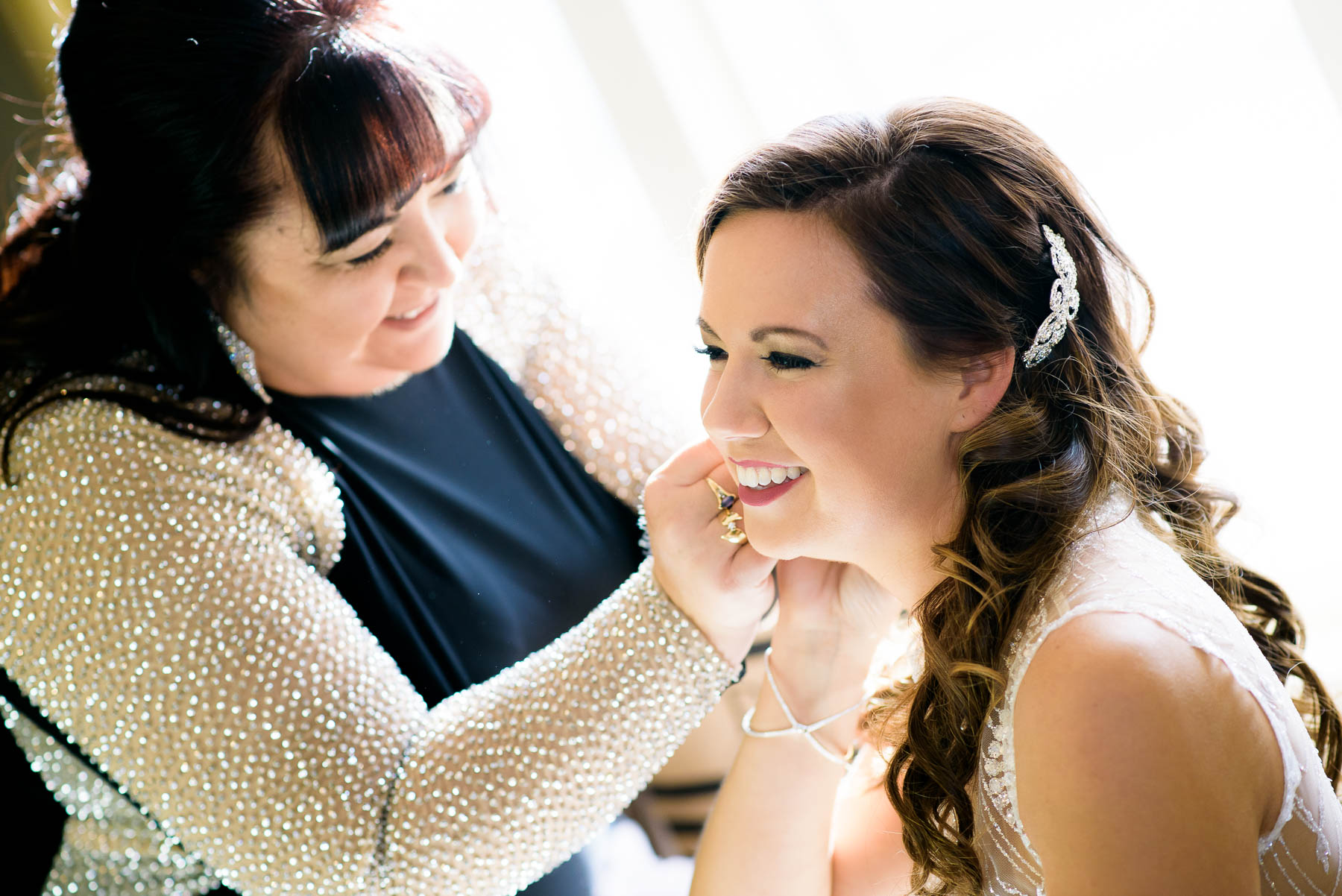 Bride and her mom getting ready during a wedding at the Manor House in Littleton, Colorado.