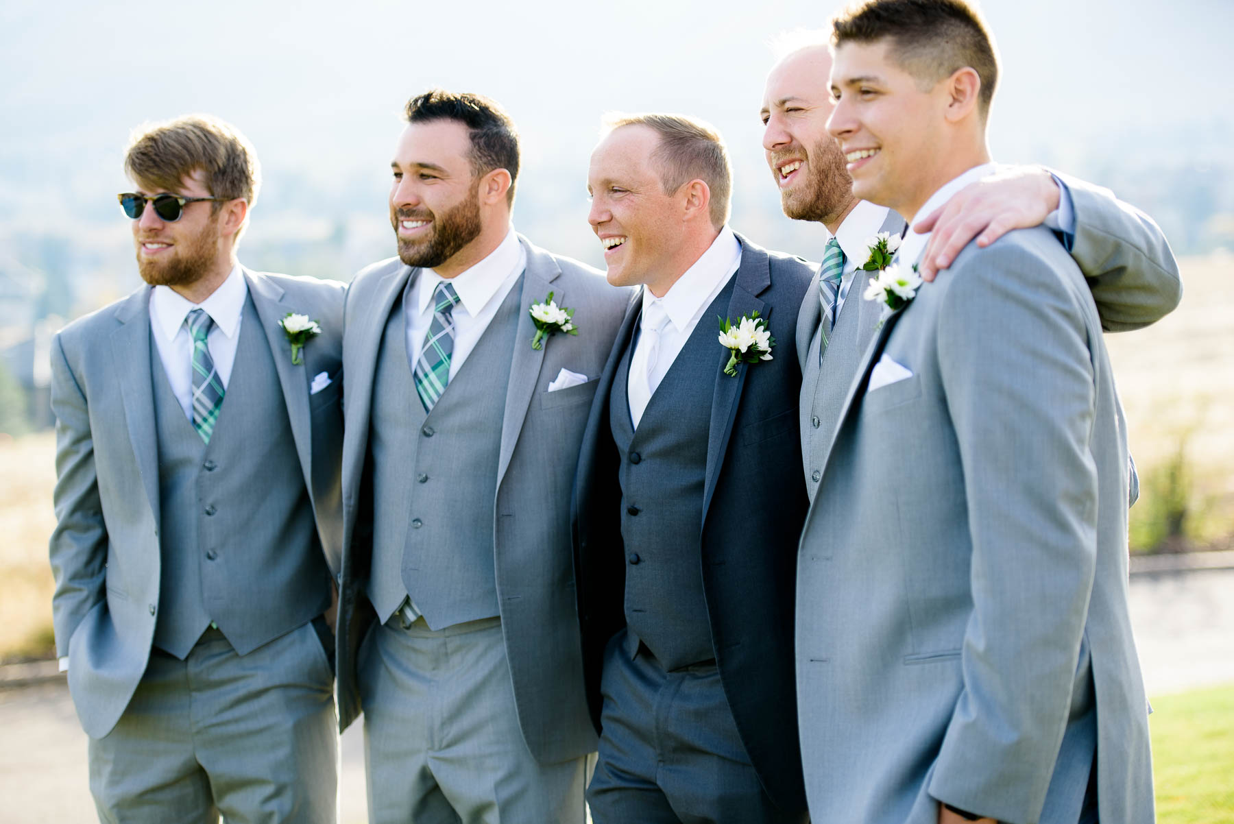 Groomsmen share a laugh during photos on the wedding day at the Manor House in Littleton, Colorado.