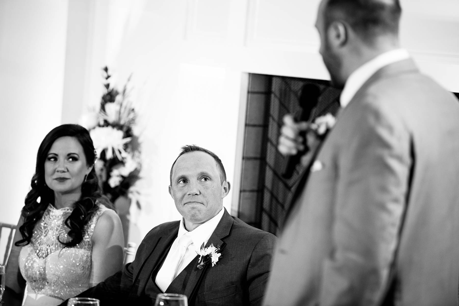 Emotional best-man toast during a wedding at the Manor House in Littleton, Colorado.