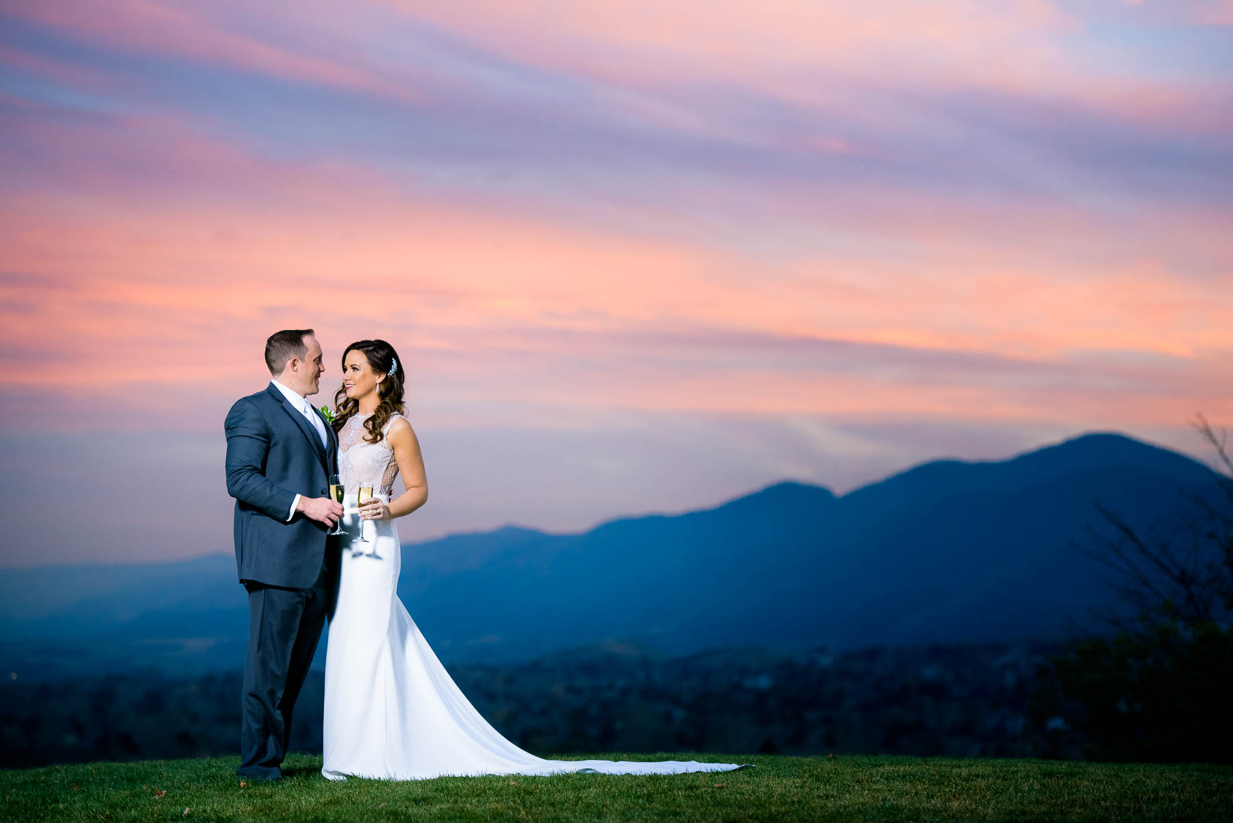 Sunset portrait of the bride and groom on their wedding day at the Manor House in Littleton, Colorado.