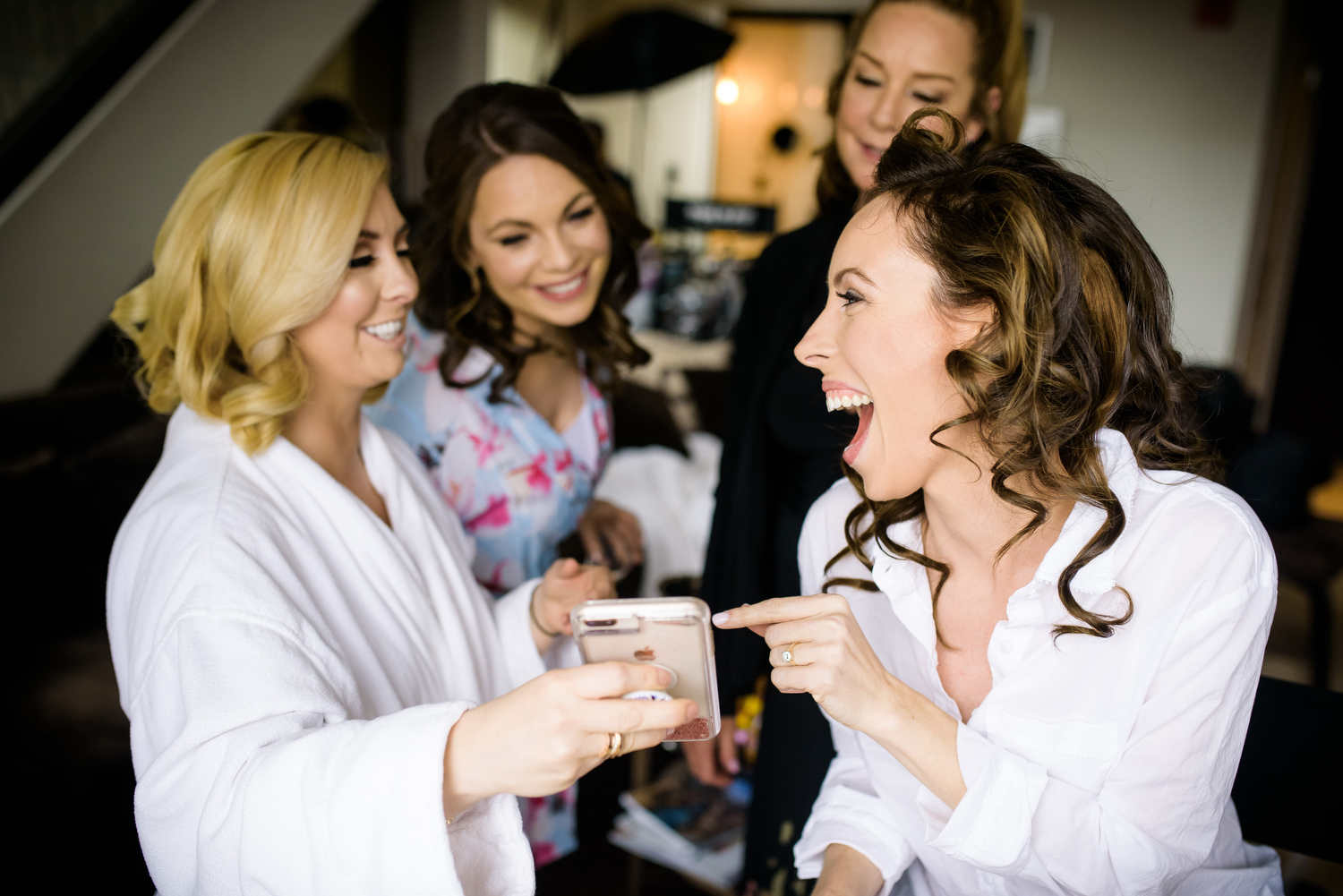 Funny photo of bride & bridesmaids getting ready before her wedding at the Thompson Chicago.