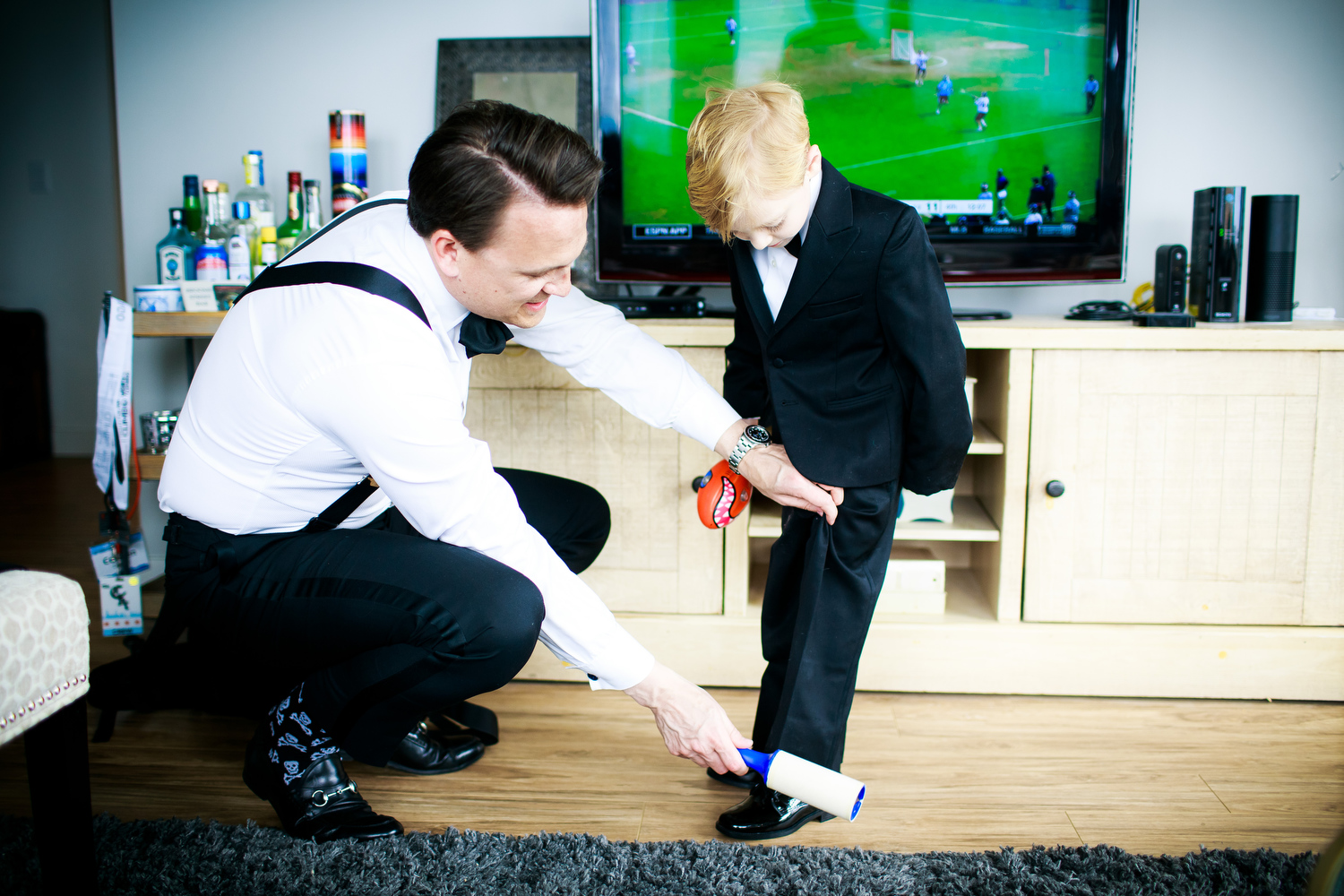 Ring bearer getting ready before a Thompson Chicago wedding.