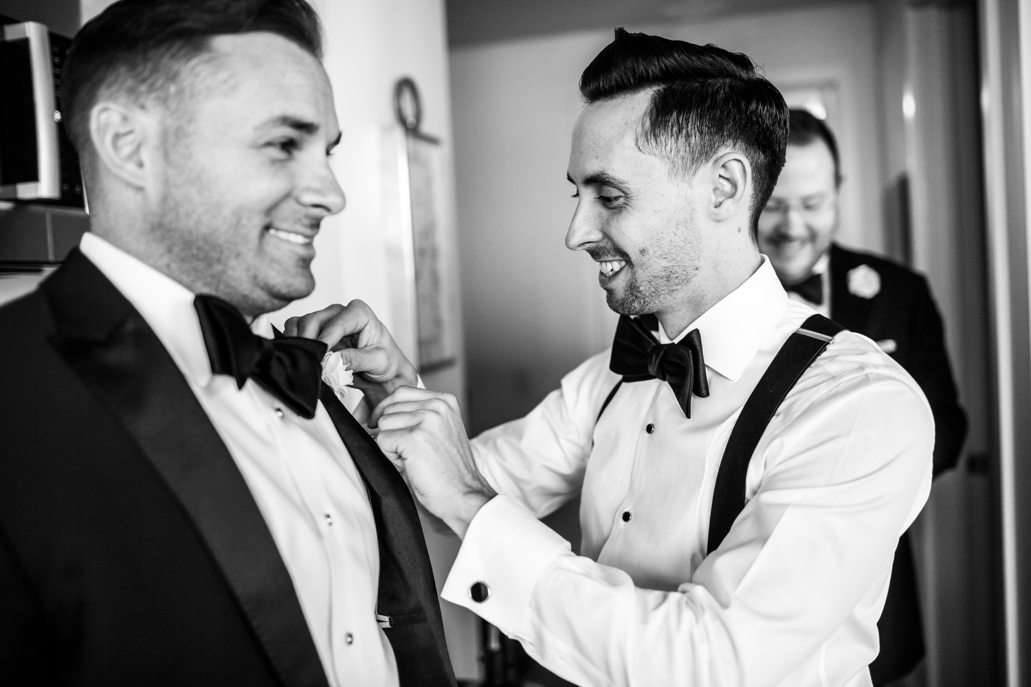 Groom and groomsmen getting ready before his Thompson Chicago wedding.