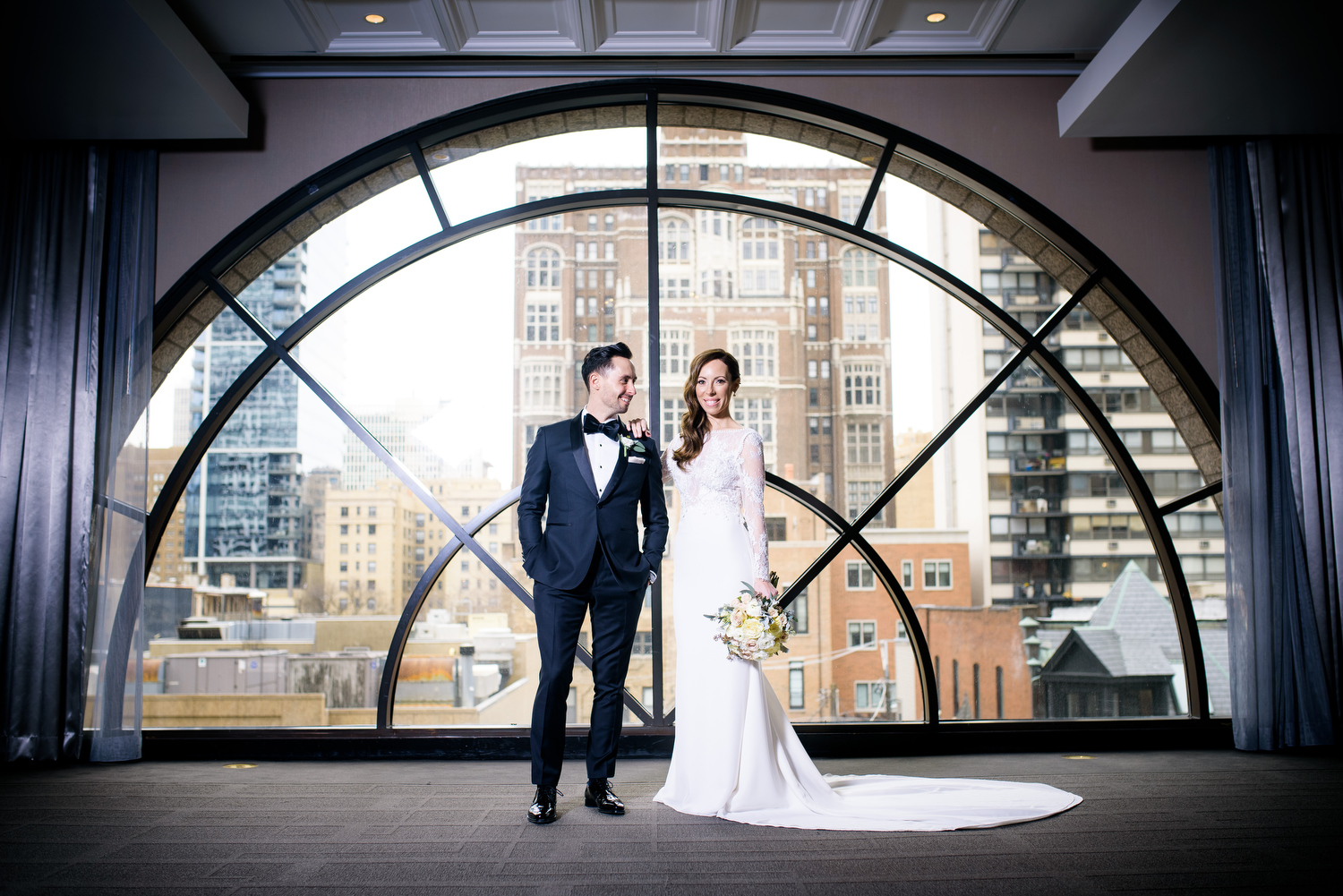 Creative wedding photo of the bride and groom in the Circle Room at the Thompson Chicago.